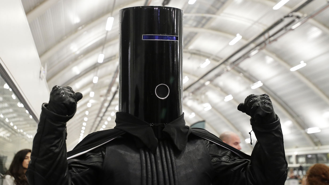 Lord Buckethead of the Monster Raving Loony Party poses for the media as ballot papers are counted at Britain's Prime Minister Boris Johnson's Uxbridge and South Ruislip constituency count declaration at Brunel University in Uxbridge, London.