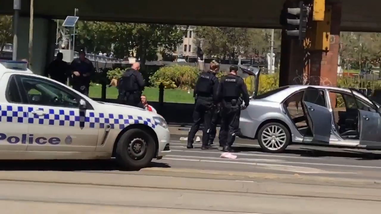 Heavily armed police have arrested a man in the Melbourne CBD.