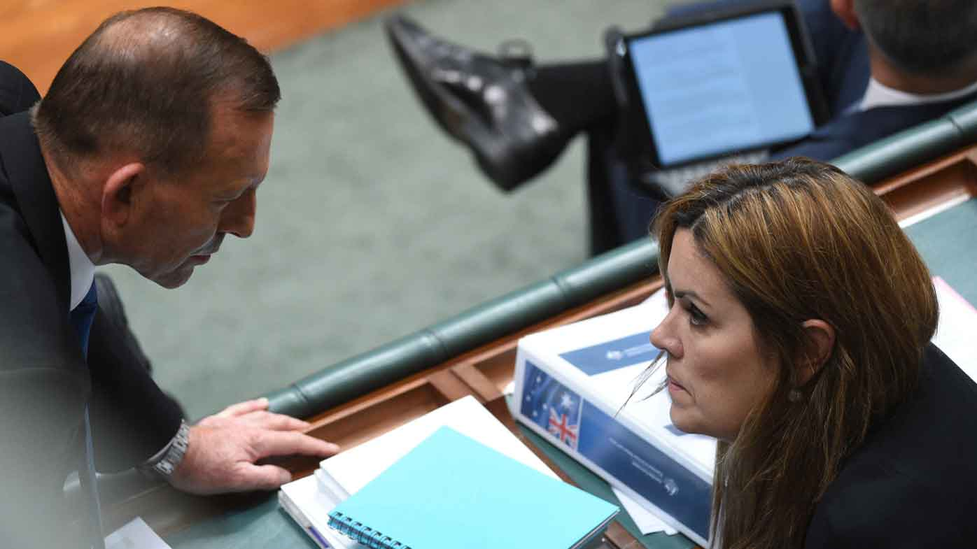 Tony Abbott speaks to Peta Credlin in 2015. (AAP)