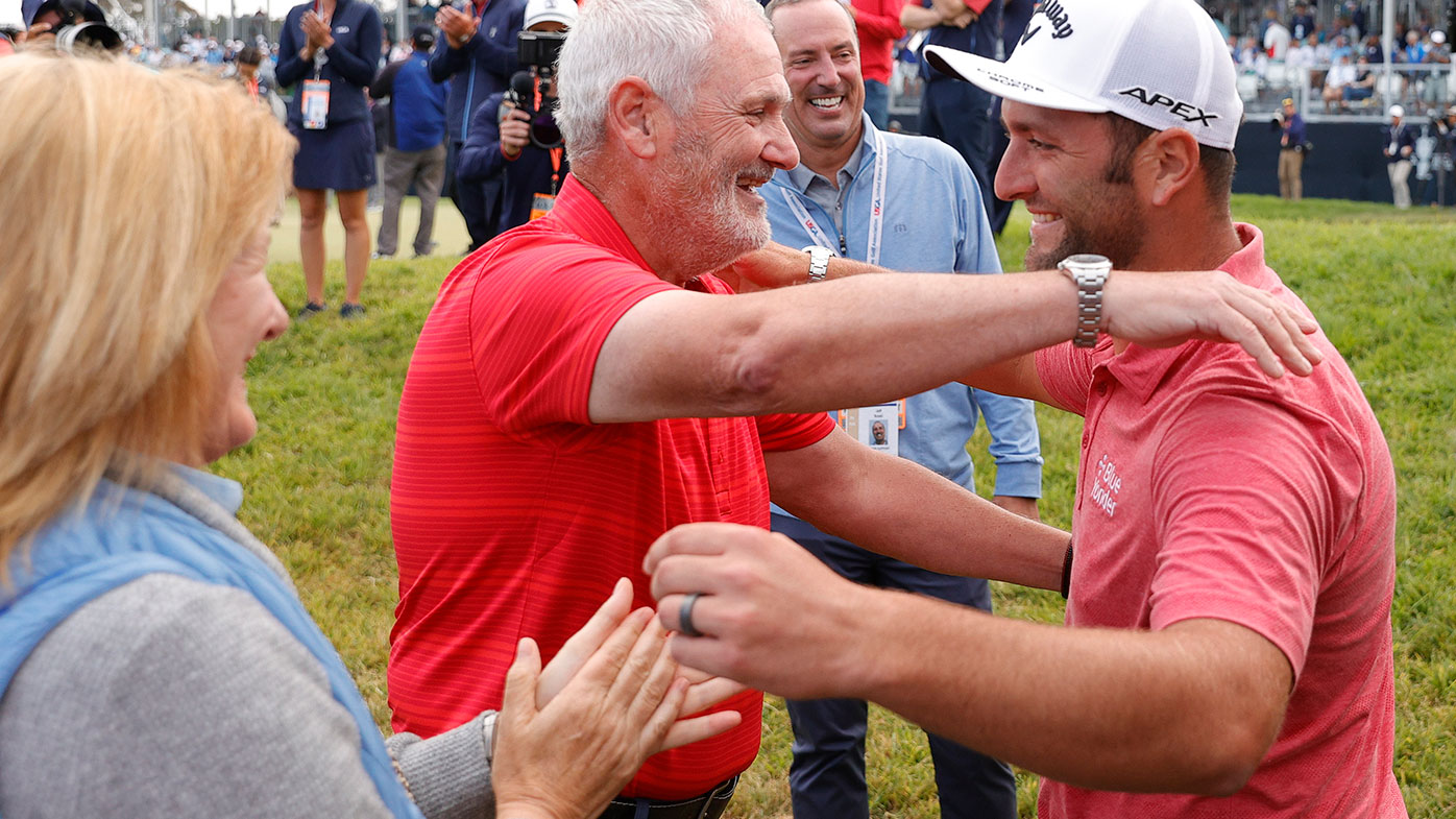 Jon Rahm of Spain celebrates with his father, Edorta Rahm (C), and mother, Ángela (L), after making a putt for birdie on the 18th green during the final round of the 2021 U.S. Open.
