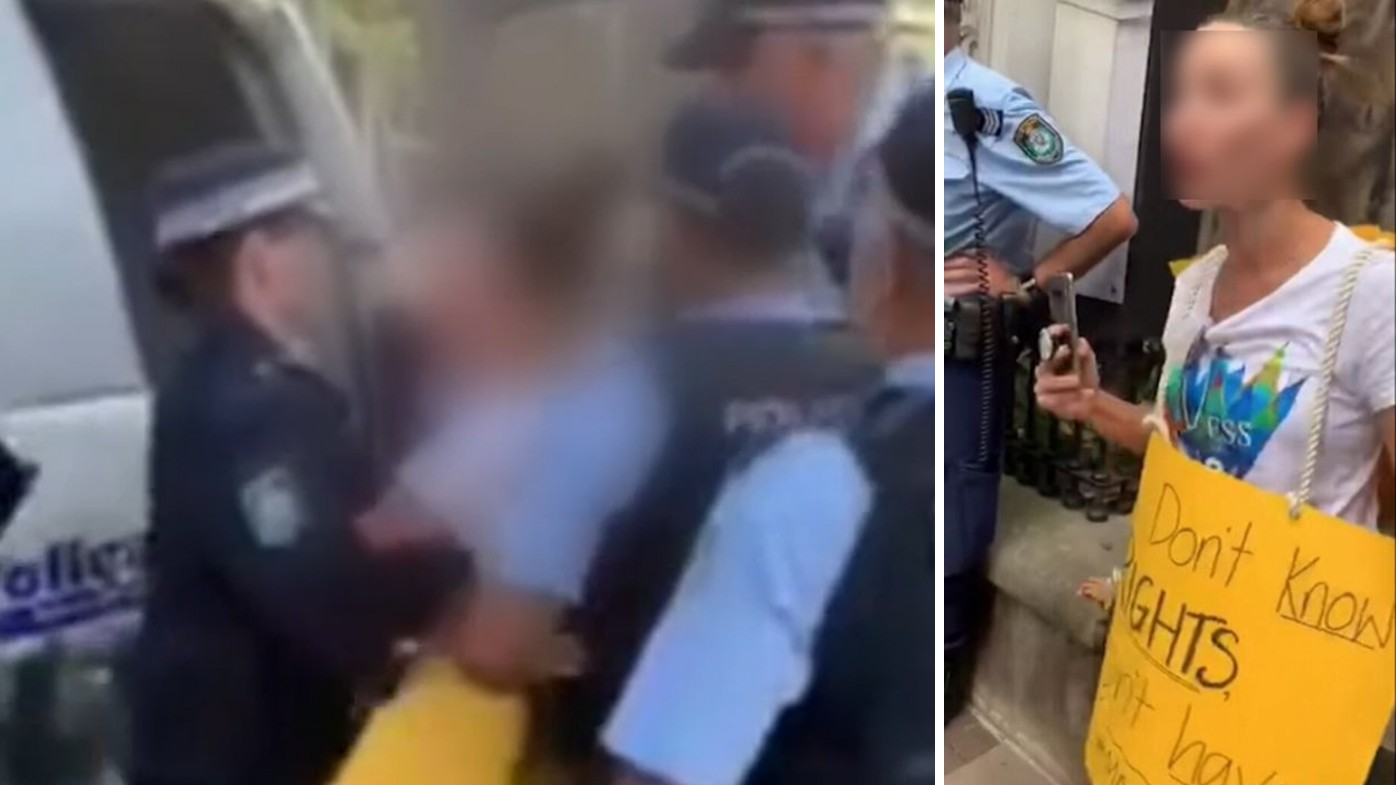 'Leave mummy alone': Protester arrested in front of young son