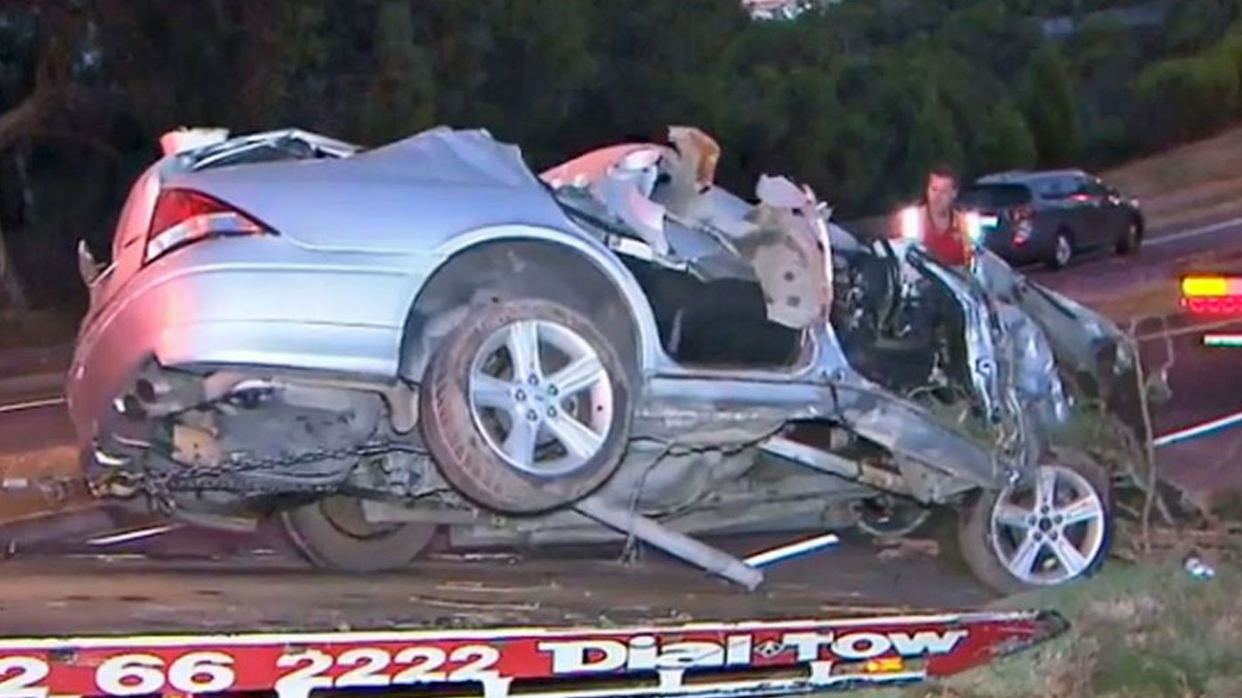 The silver Ford Sedan crashed into a creek bed off Nelson Rd in Para Hills, Adelaide.