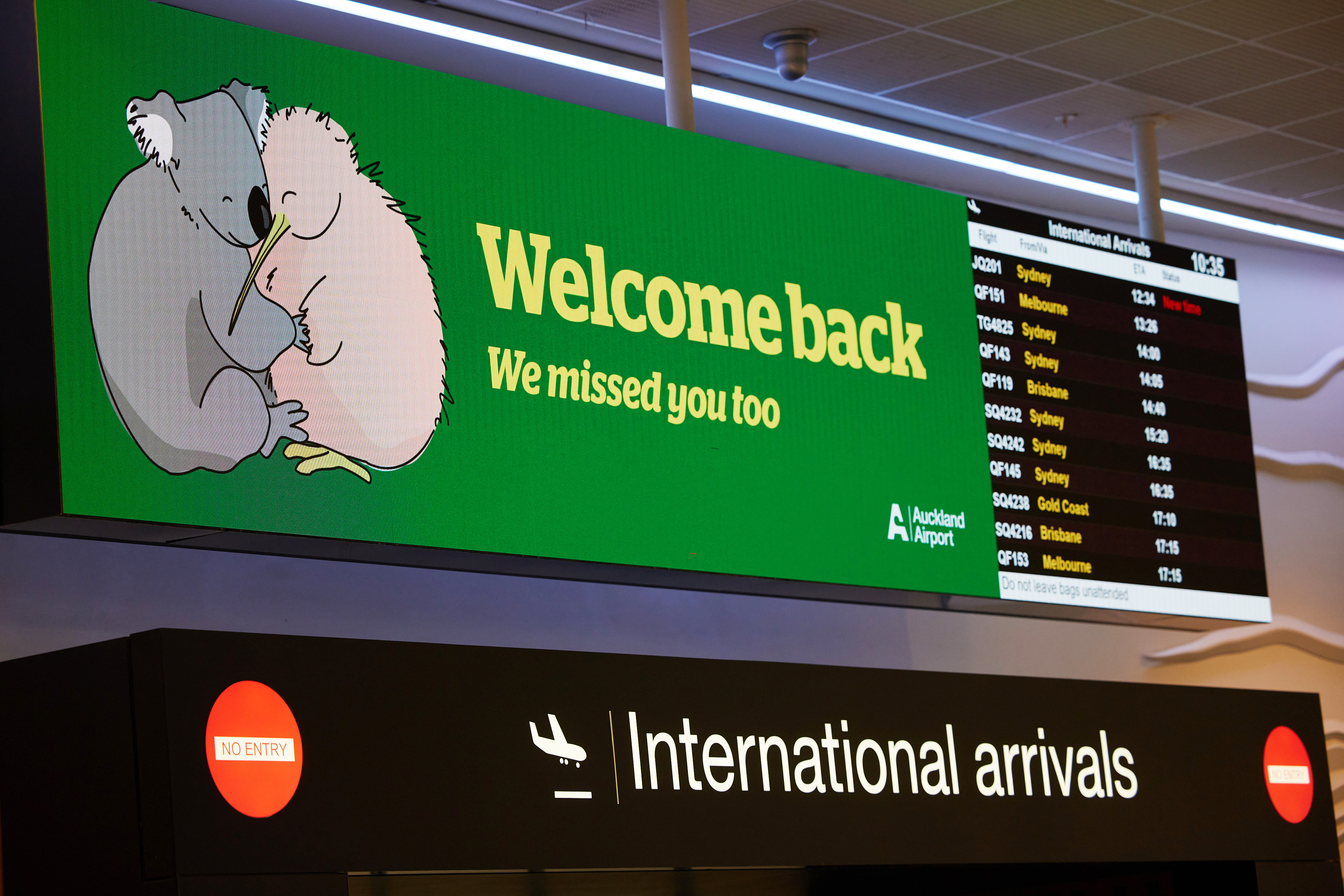 A welcome back sign features a koala and a kiwi at Auckland International Airport in Auckland, New Zealand, on Monday, April 19, 2021. Australia and New Zealand on Monday started their first quarantine-free flights since the pandemic began, after they successfully halted Covid-19 transmissions from spreading through their nations. Photographer: Brendon O'Hagan/Bloomberg