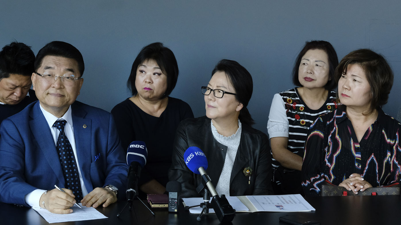 Bernard J. Lim( left) from the Korean Friendship Bell Preservation Committee and Youngmi YI, (centre) with Myung Won Cultural Foundation  answer questions during a news conference in LA's Koreatown.