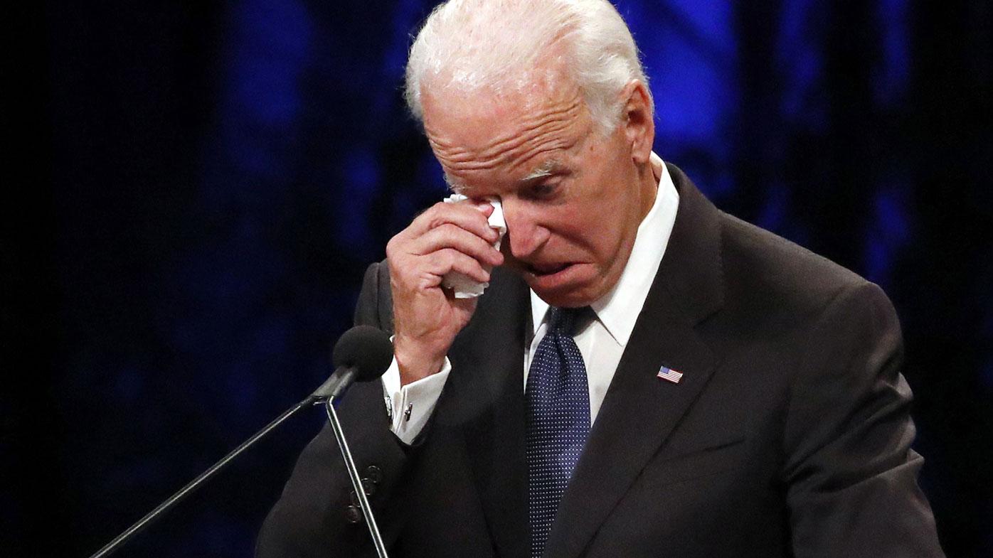 Former Vice President Joe Biden wipes a tear away while giving a tribute during memorial service at North Phoenix Baptist Church for Sen. John McCain, R-Ariz., on Thursday, Aug. 30, 2018, in Phoenix