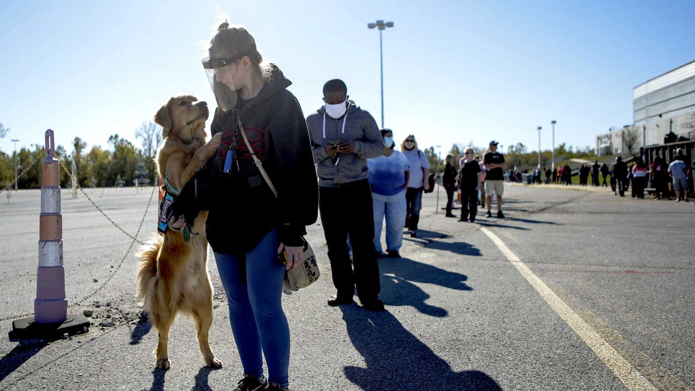 Voters line up to cast a ballot in St Charles, Missouri.