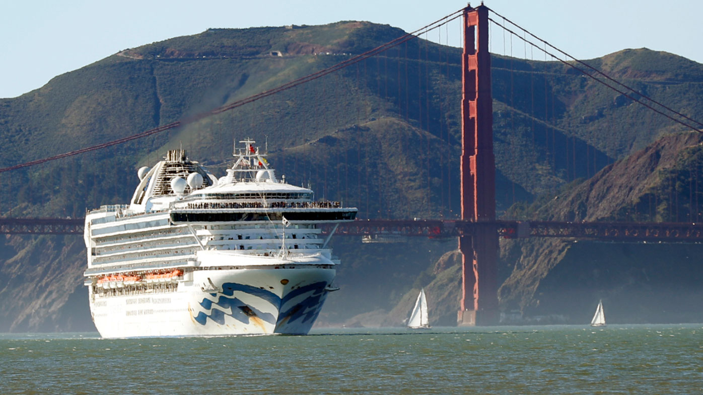 In this Feb. 11, 2020 photo, the Grand Princess cruise ship passes the Golden Gate Bridge as it arrives from Hawaii in San Francisco. California's first coronavirus fatality is an elderly patient who apparently contracted the illness on a cruise, US authorities said Wednesday, March 4.