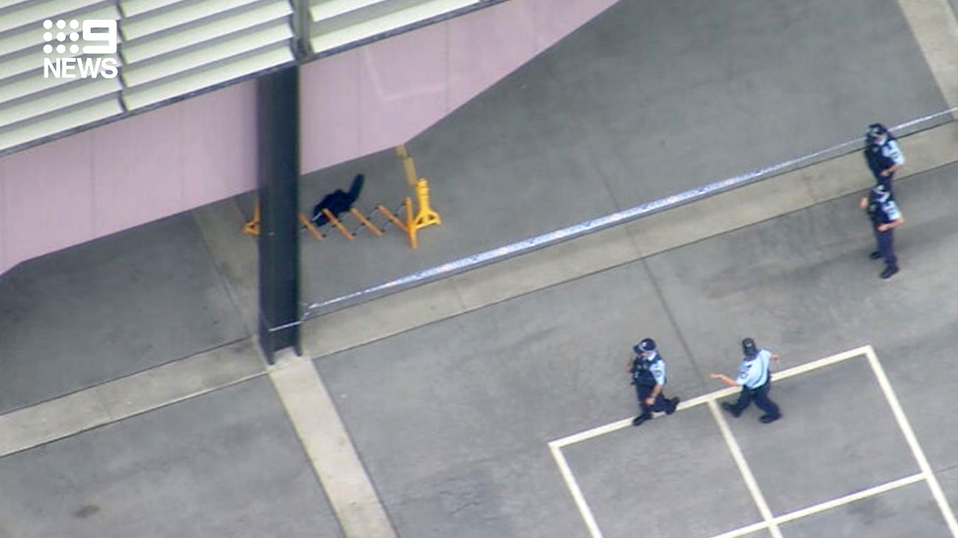 Blood can be seen inside a crime scene at Arthur Phillip High School. The male student was rushed to hospital but is reportedly stable.