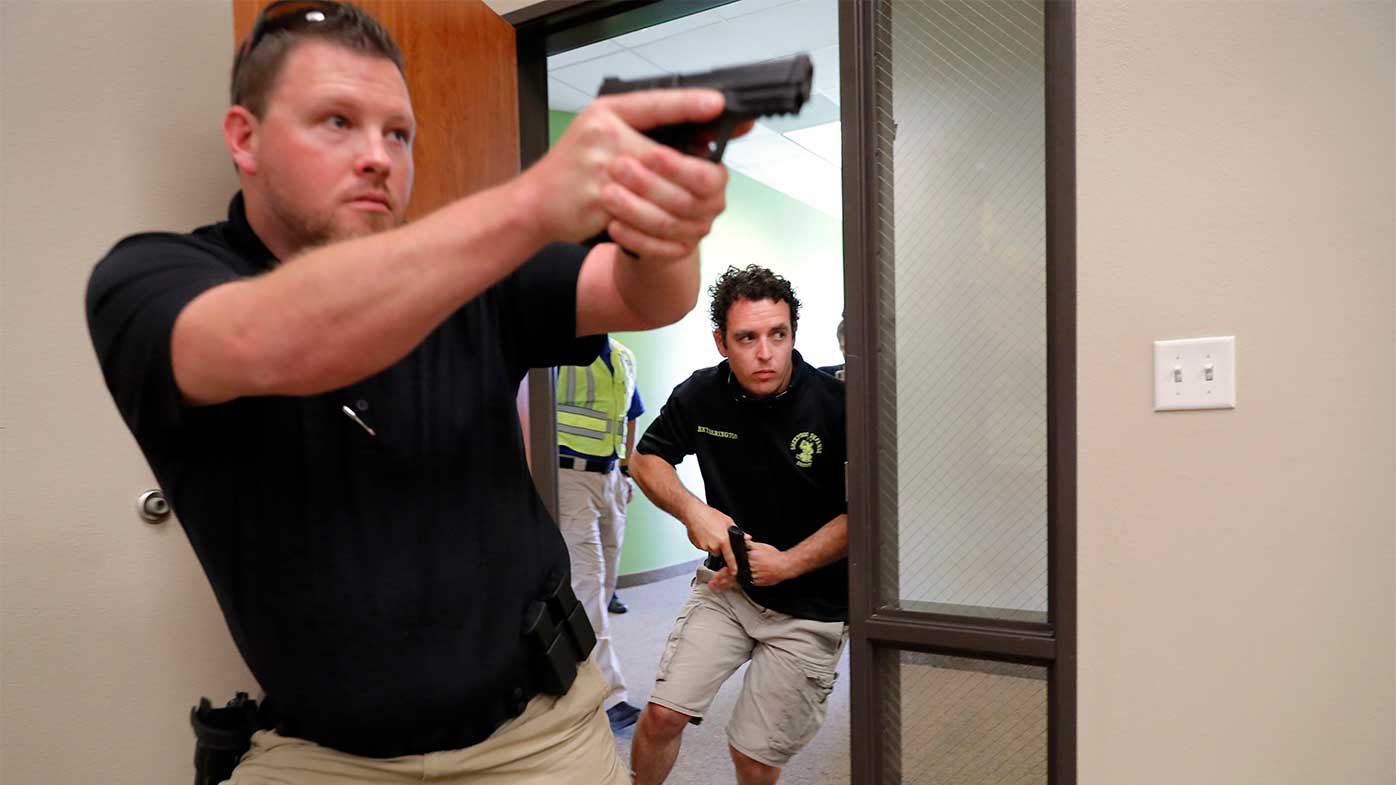 Participants in a Texas training program that teaches civilians how to fight back against mass shootings in churches.