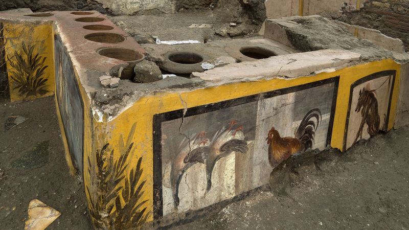 Experts say it is the first time such a hot-food-drink eatery — known as a thermopolium — was completely unearthed. (AP)