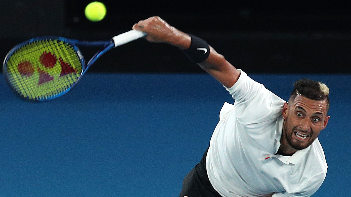 Nick Kyrgios hits a serve during the Australian Open Rally for Relief