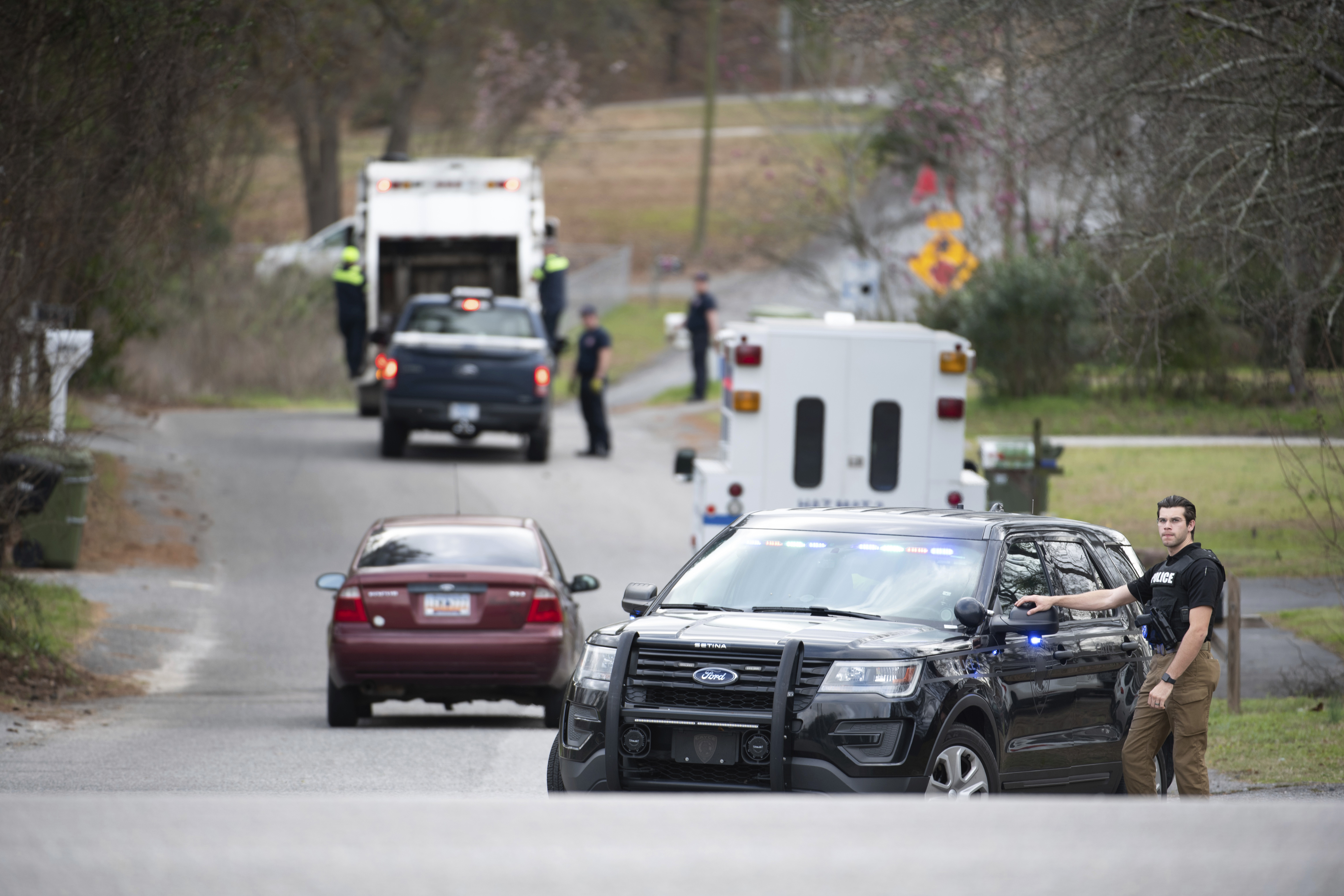 A Cayce police officer blocks an entrance to the Churchill Heights neighbourhood.