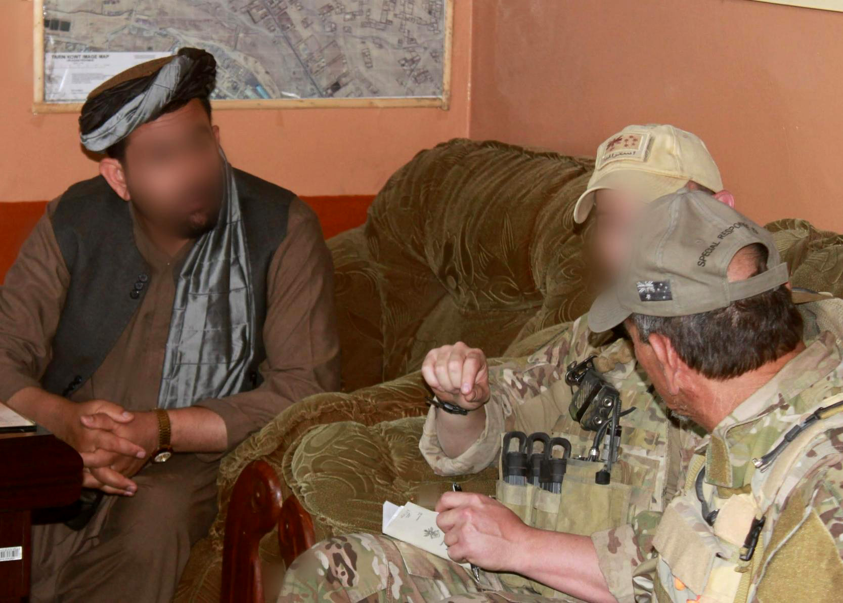 Former ADF soldier Shane Healy (middle) meets with a local Afghan on a 2012 mission in Uruzgan province.