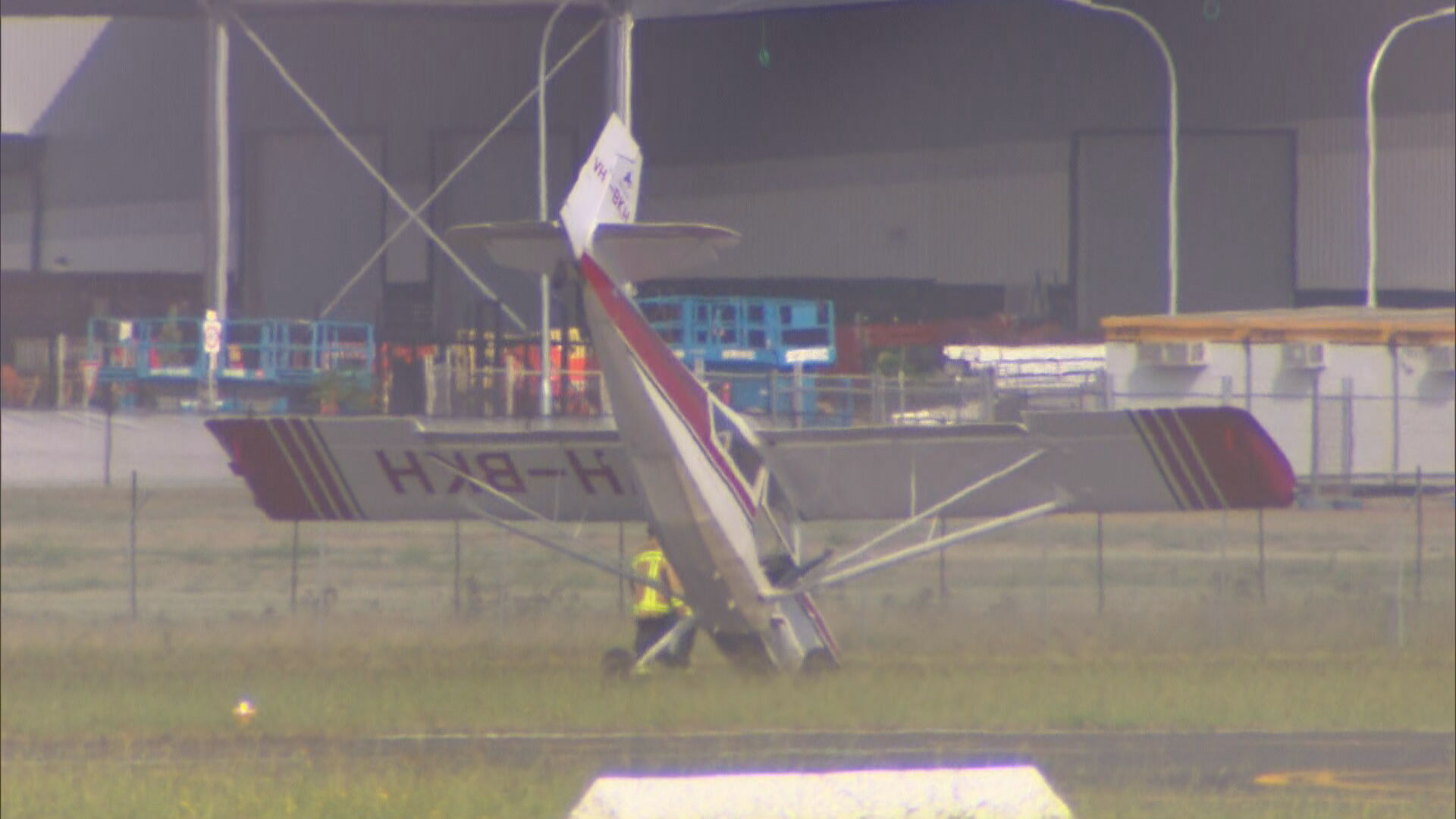 Pilot crash lands light plane on its nose at Bankstown Airport