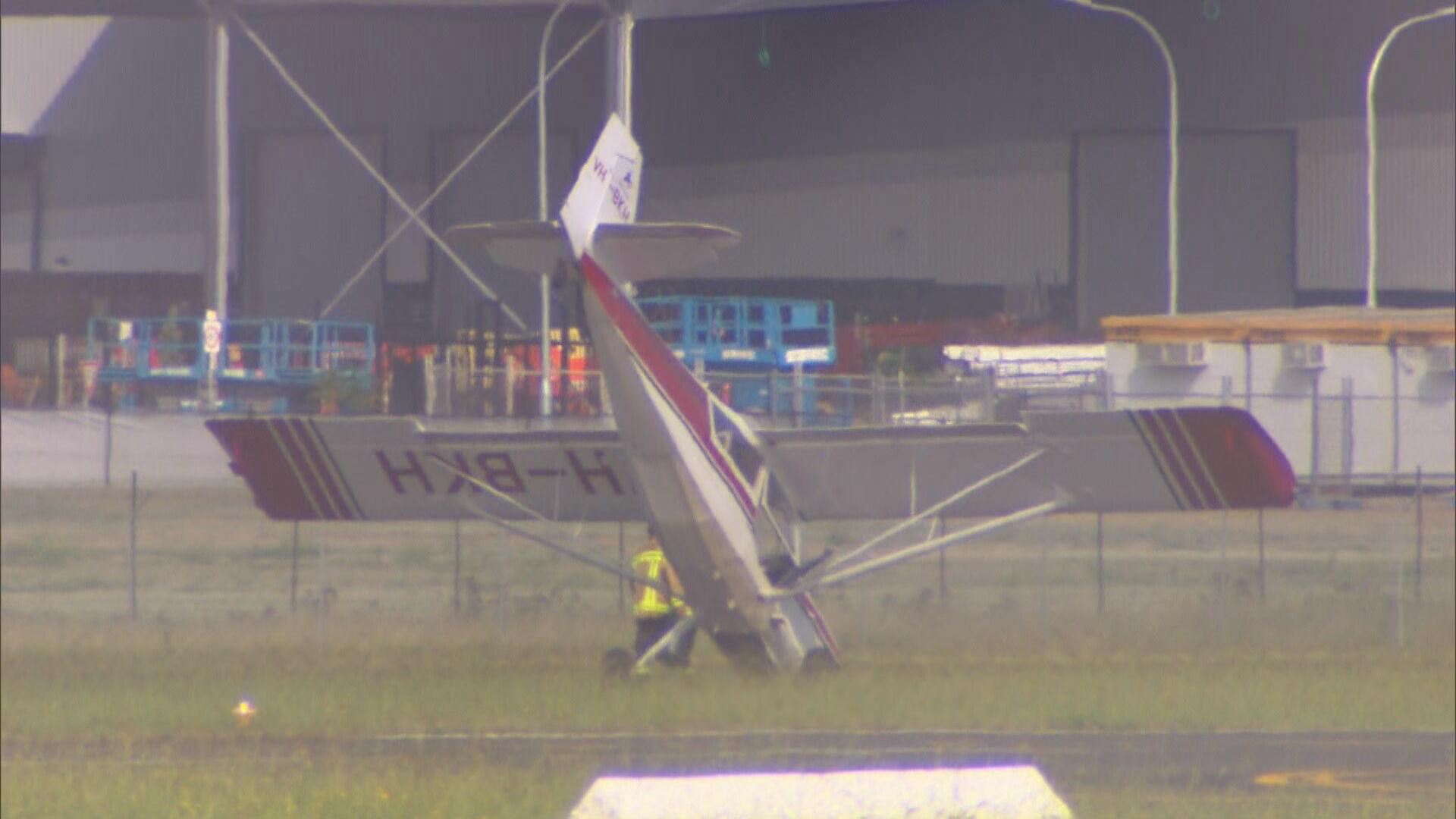 Pilot crash lands light plane on its nose at Bankstown Airport