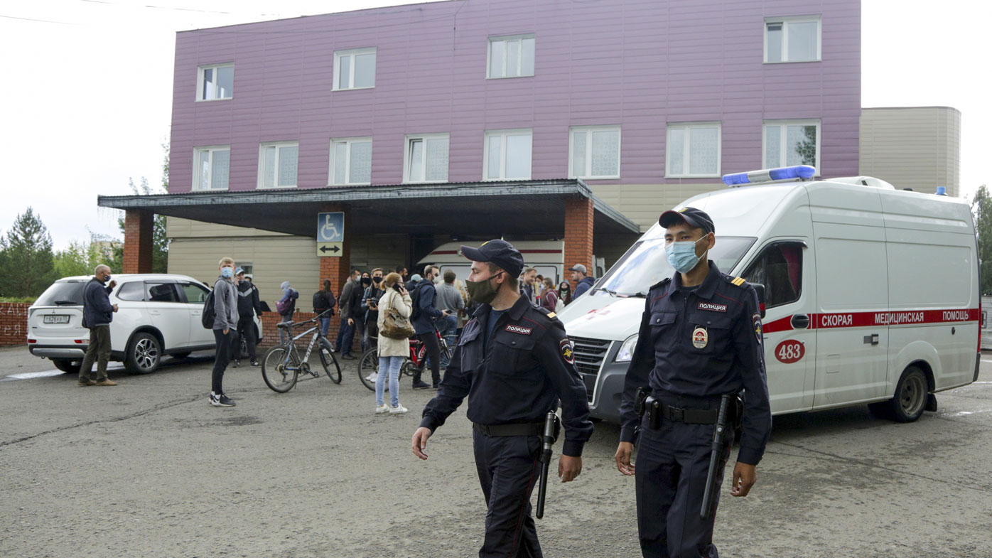 Police patrol an area, as journalists gather at the Omsk Ambulance Hospital No. 1, intensive care unit where Alexei Navalny was hospitalised in Omsk, Russia (Photo: August 21, 2020)