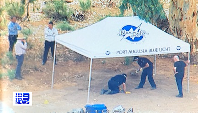 Forensic police examine the site of a suspected shallow grave in the Flinders Rangers.