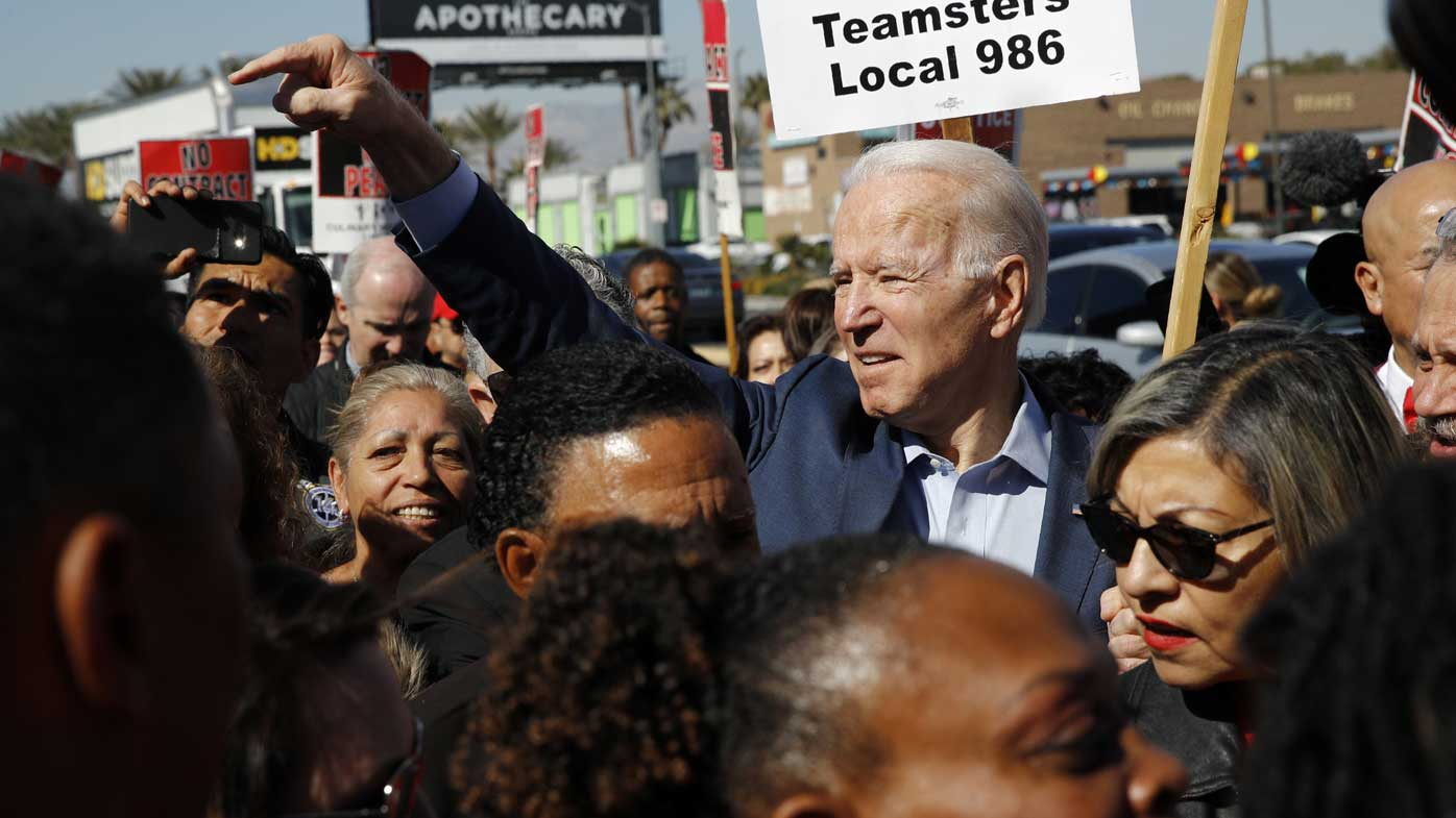 Democratic presidential candidate former Vice President Joe Biden walks on a picket line with members of the Culinary Workers Union Local 226 outside the Palms Casino in Las Vegas.