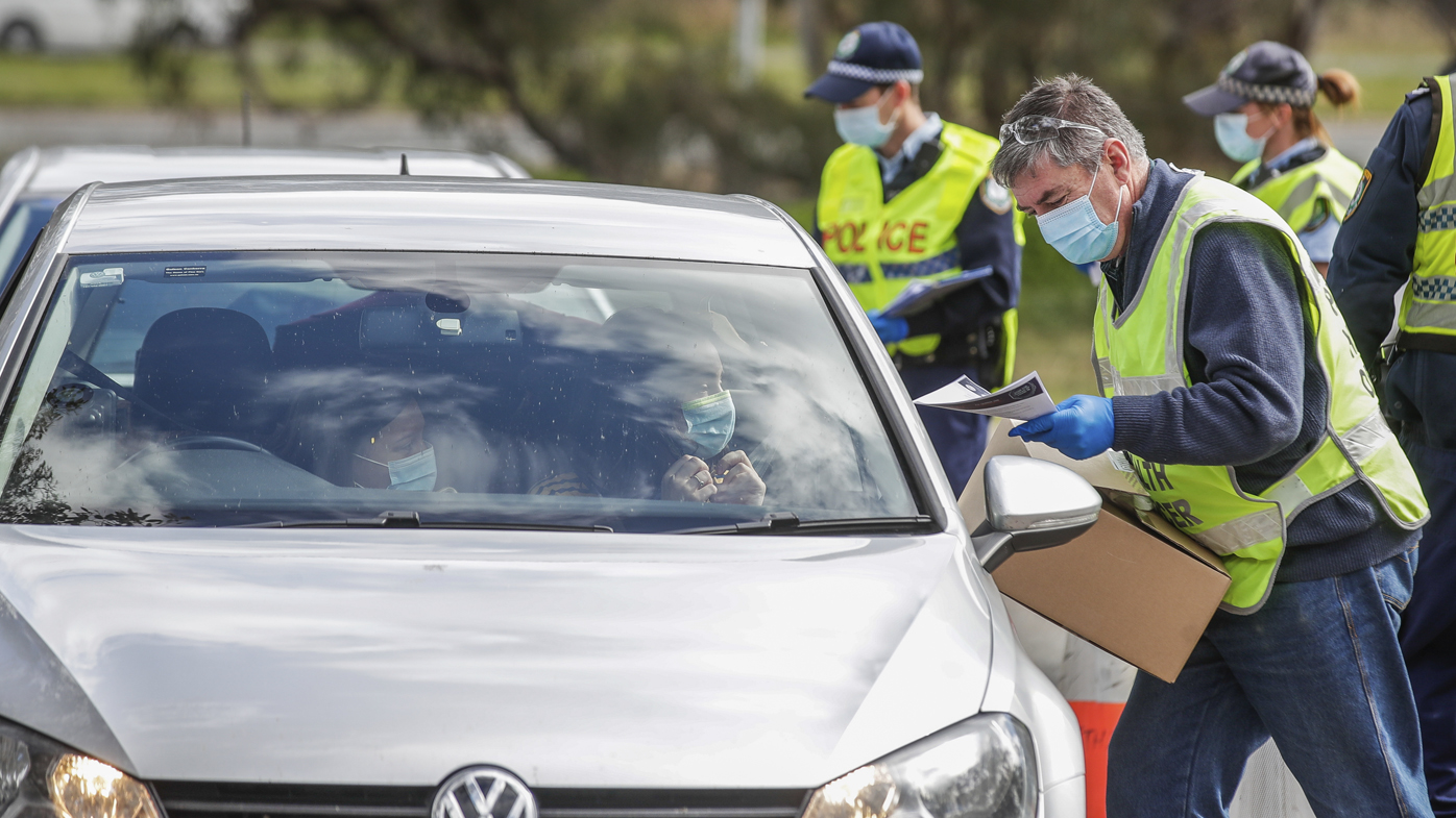 Canberra residents who have been stranded at the Victorian/NSW border arrive at a police checkpoint at Hall, at the NSW/ACT border, on Thursday 13 August 2020.