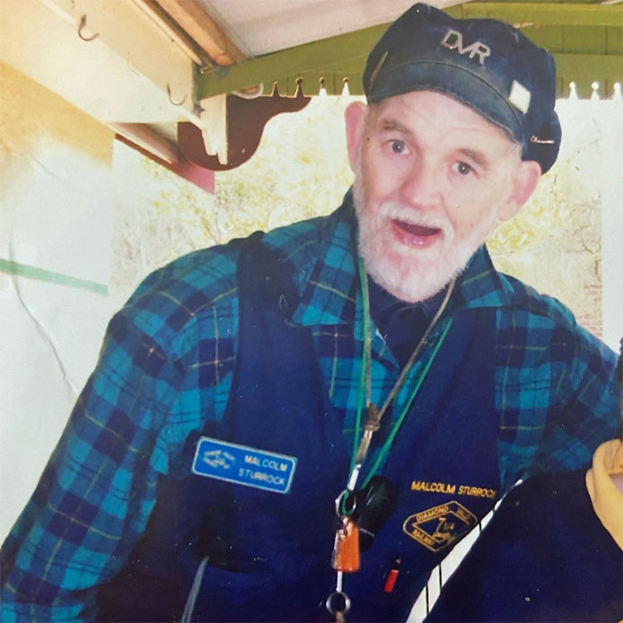 Malcolm, pictured at the Diamond Valley Railway, where he volunteered for more than 30 years.