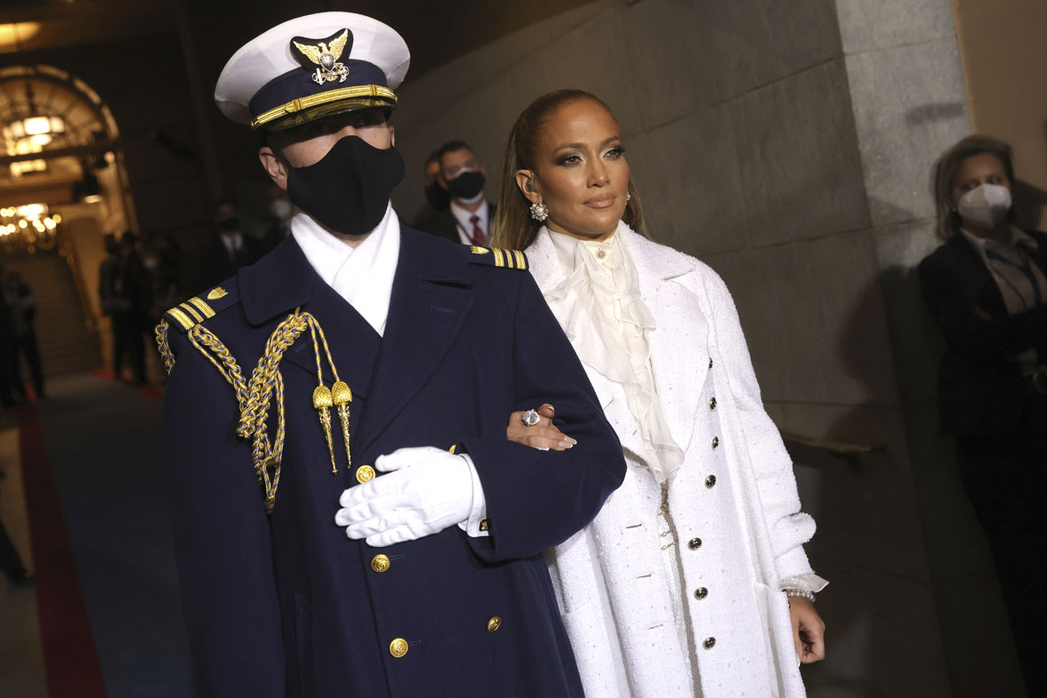 Jennifer Lopez is escorted to the 59th Presidential Inauguration at the U.S. Capitol for President-elect Joe Biden in Washington, Wednesday, Jan. 20, 2021.