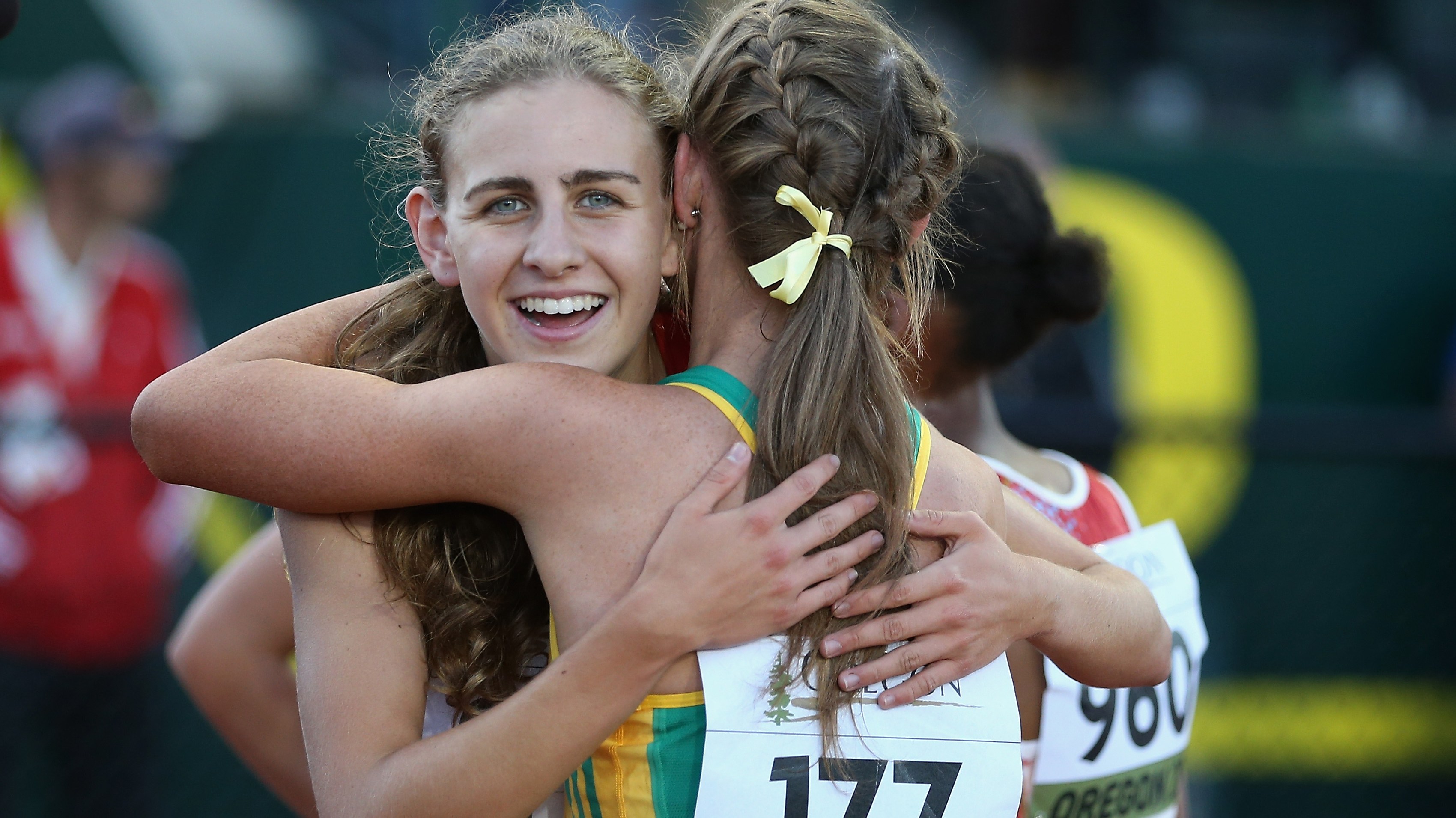 Mary Cain is embraced by Australia's Jessica Hull after the 3000m at the IAAF Junior World Championships.