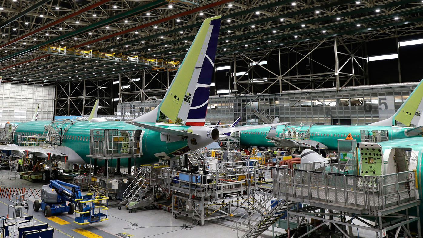 A Boeing 737 MAX 8 airplane is shown on the assembly line.