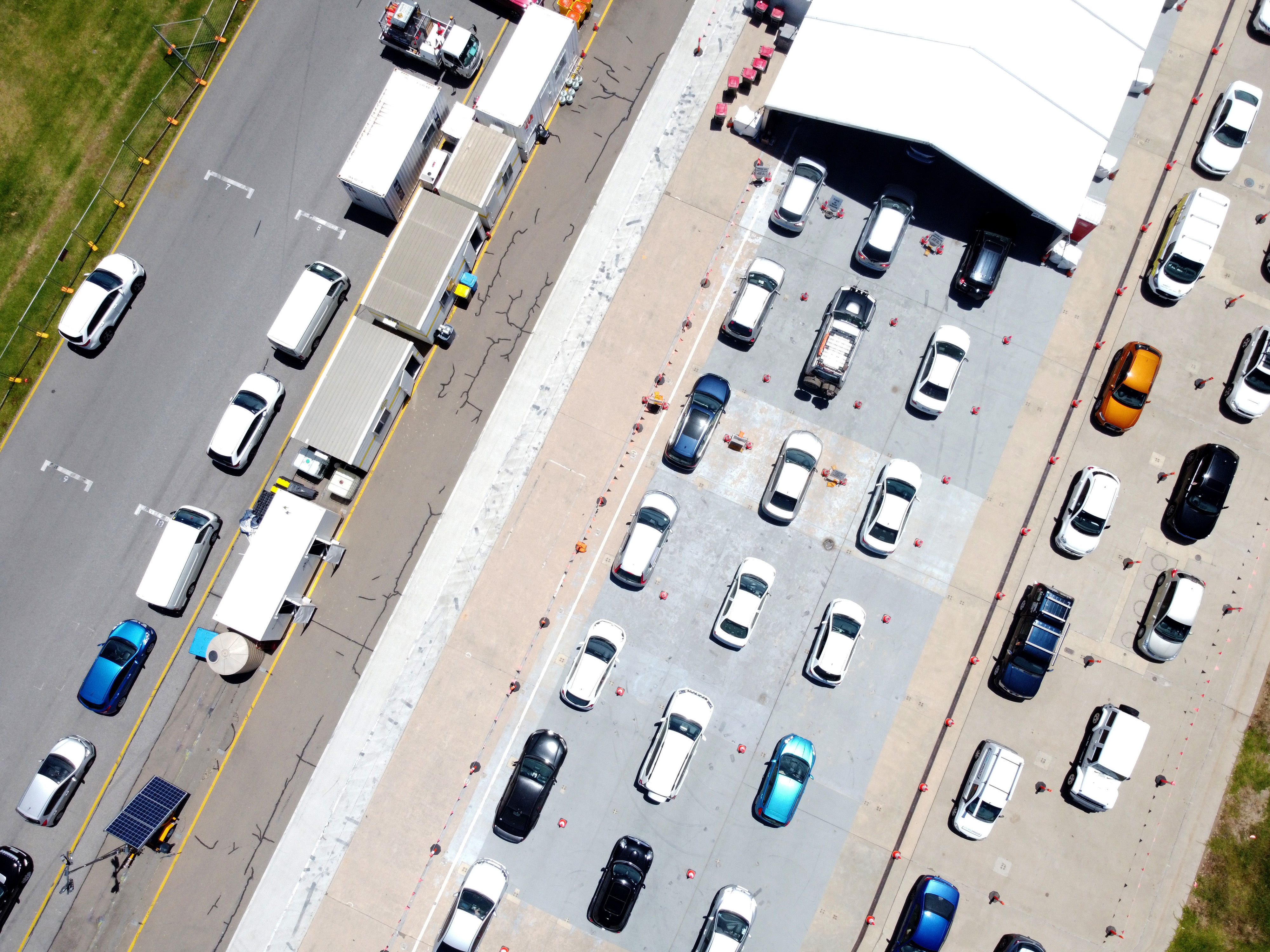 Cars queue for the COVID-19 testing facility at Victoria Park, just outside the Adelaide CBD
