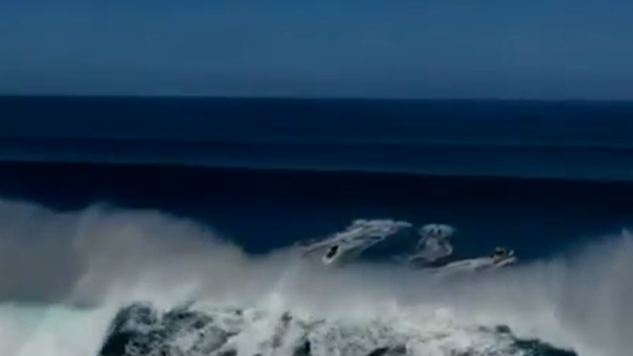 Jet skier breaks back after wave launches him into the air