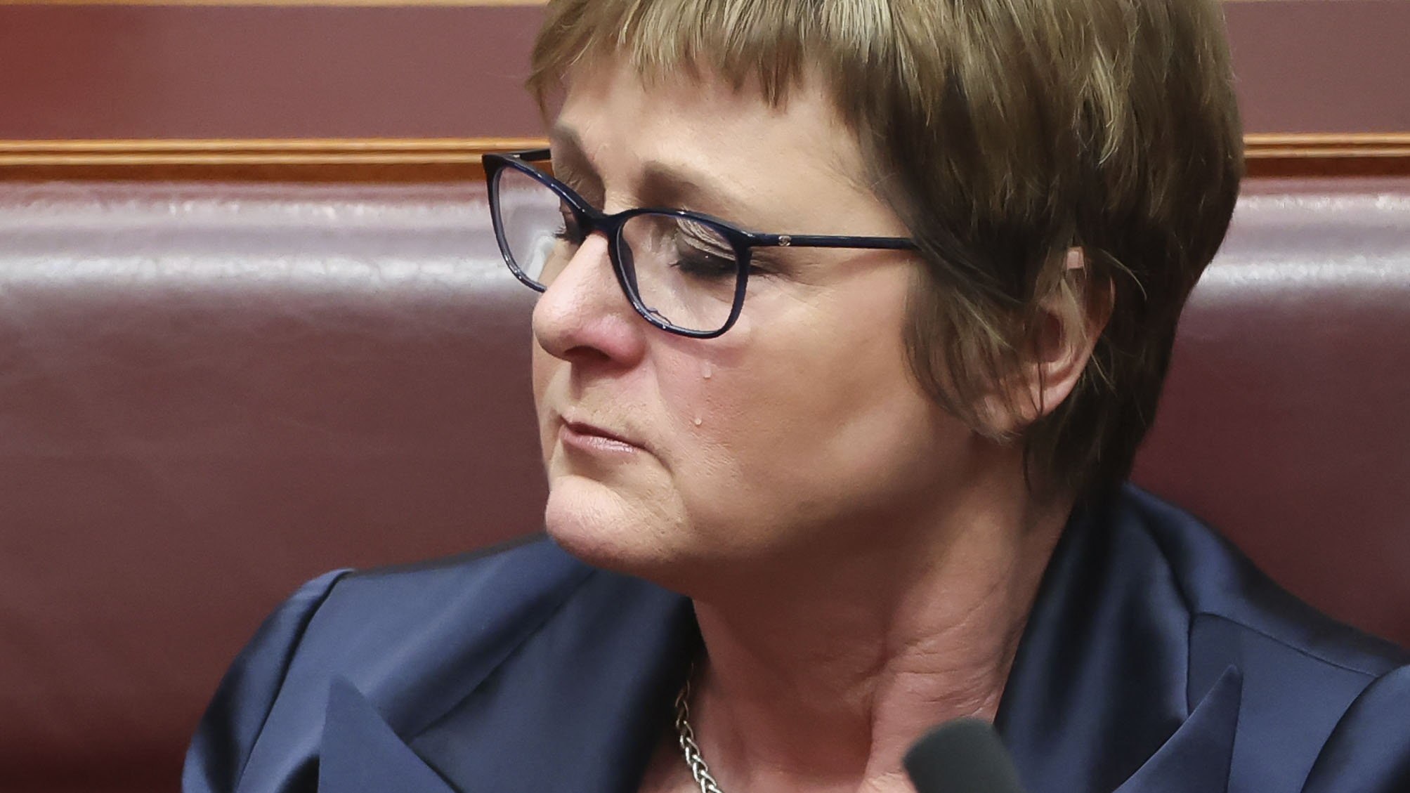 Tears stream down the face of Minister for Defence Linda Reynolds during Question Time at Parliament House in Canberra today. Photo: Alex Ellinghausen