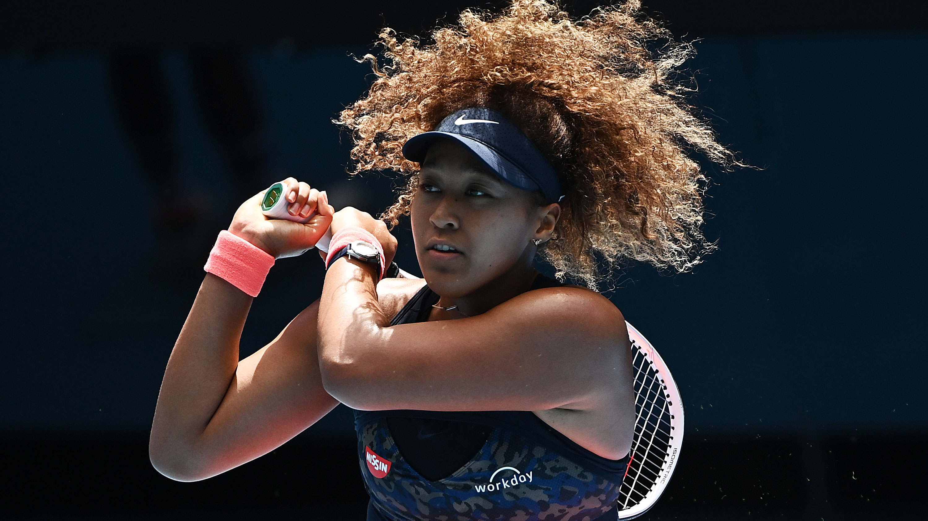 Naomi Osaka hits a backhand in her Australian Open quarter final.
