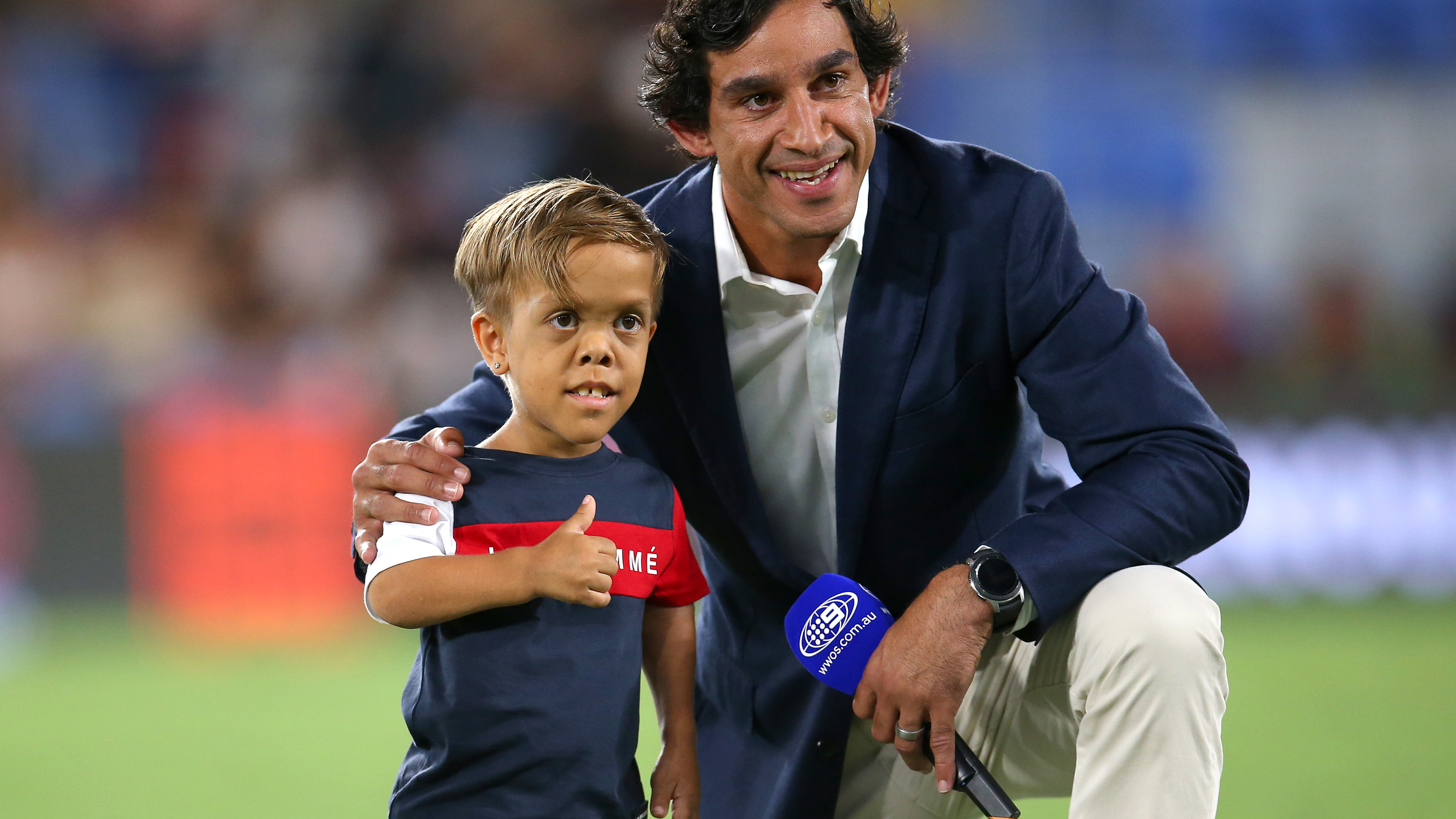 Johnathan Thurston embracing Quaden Bayles at last year's All Star Game.