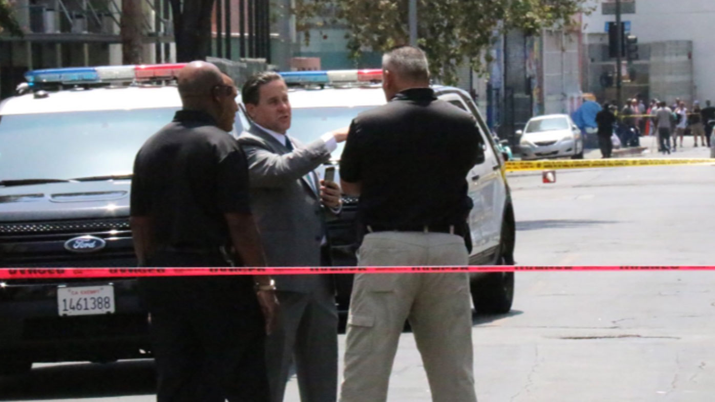 Police hunt female suspect after LA shootings