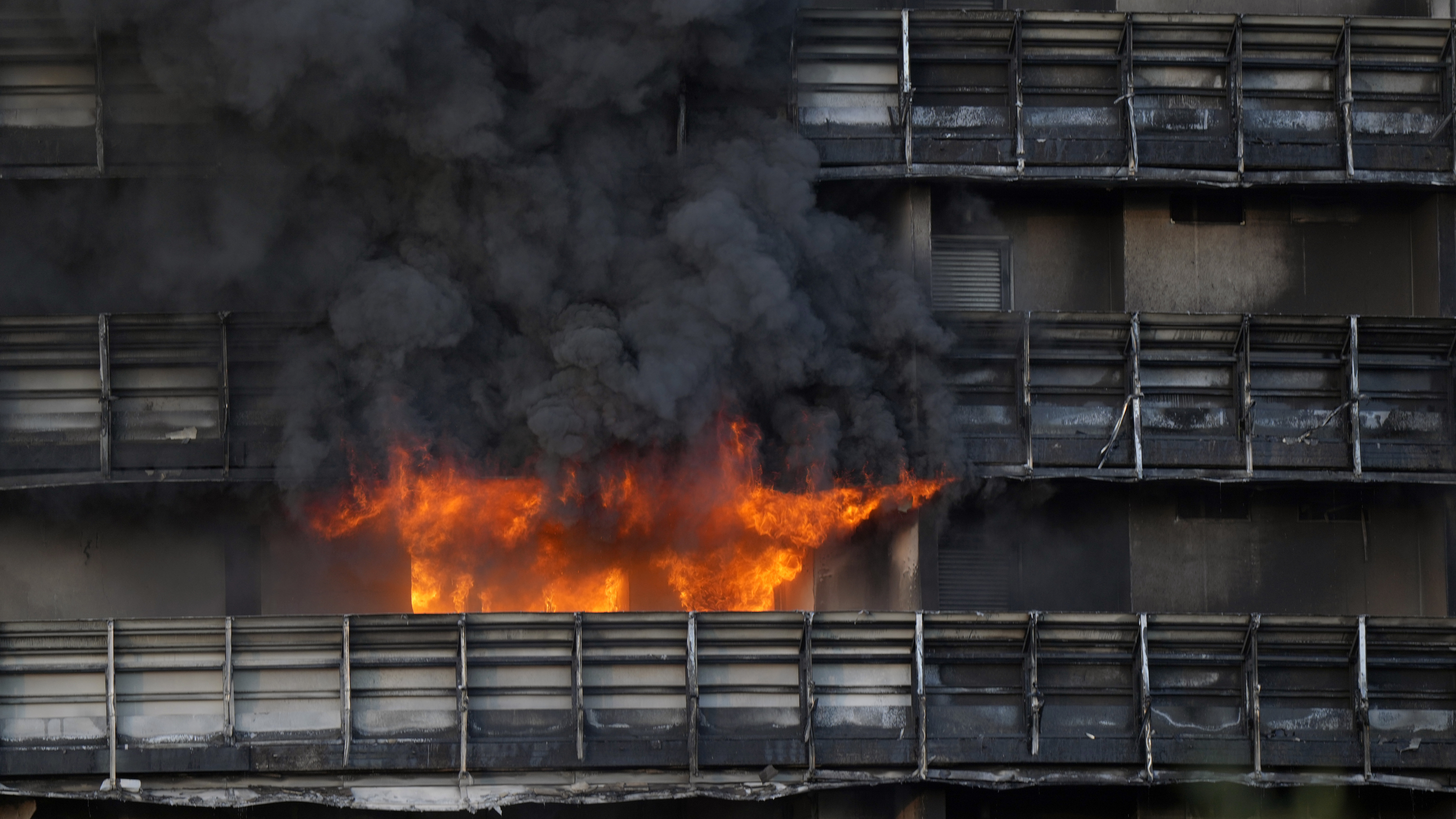 Firefighters were battling a blaze on Sunday that spread rapidly through a recently restructured 60-meter-high, 16-story residential building in Milan.