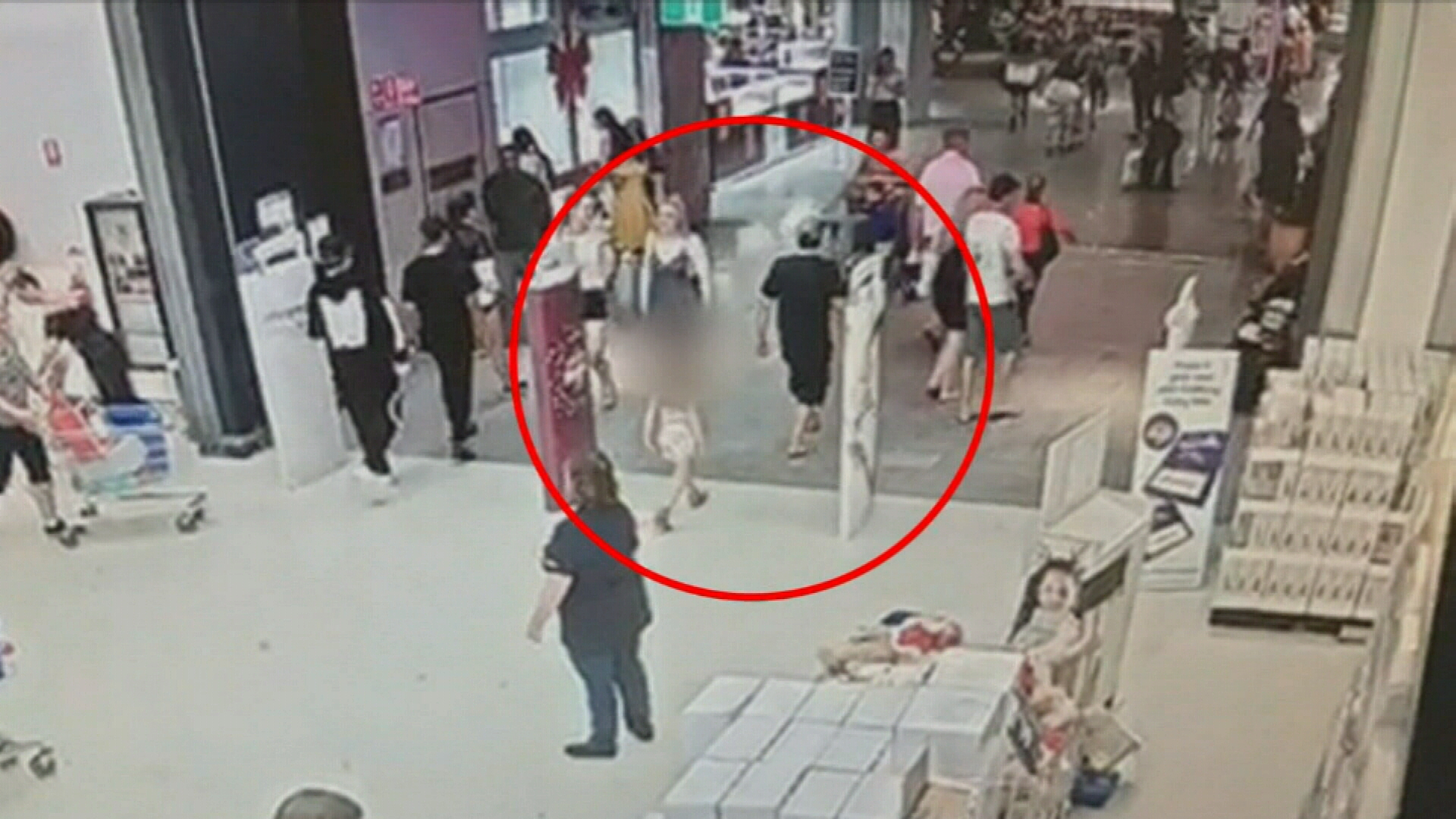 CCTV shows the little girl being lead away by Sterling Free.