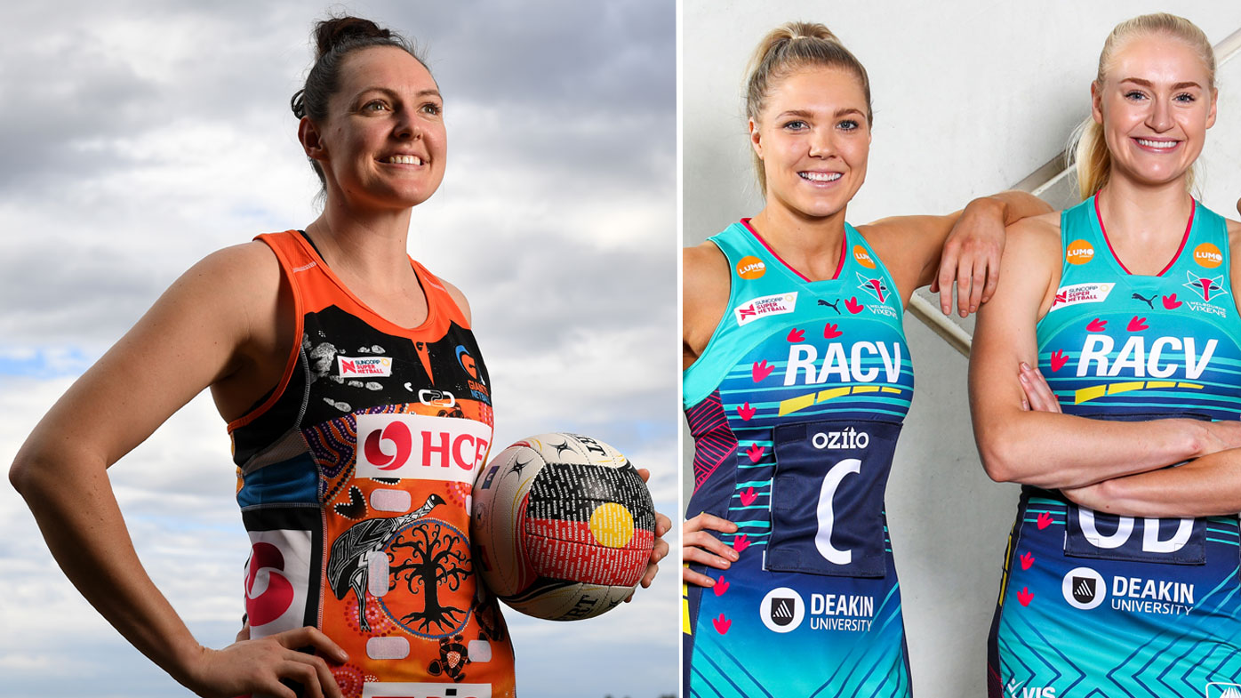 Players pose in their uniforms specially designed for Indigenous Round