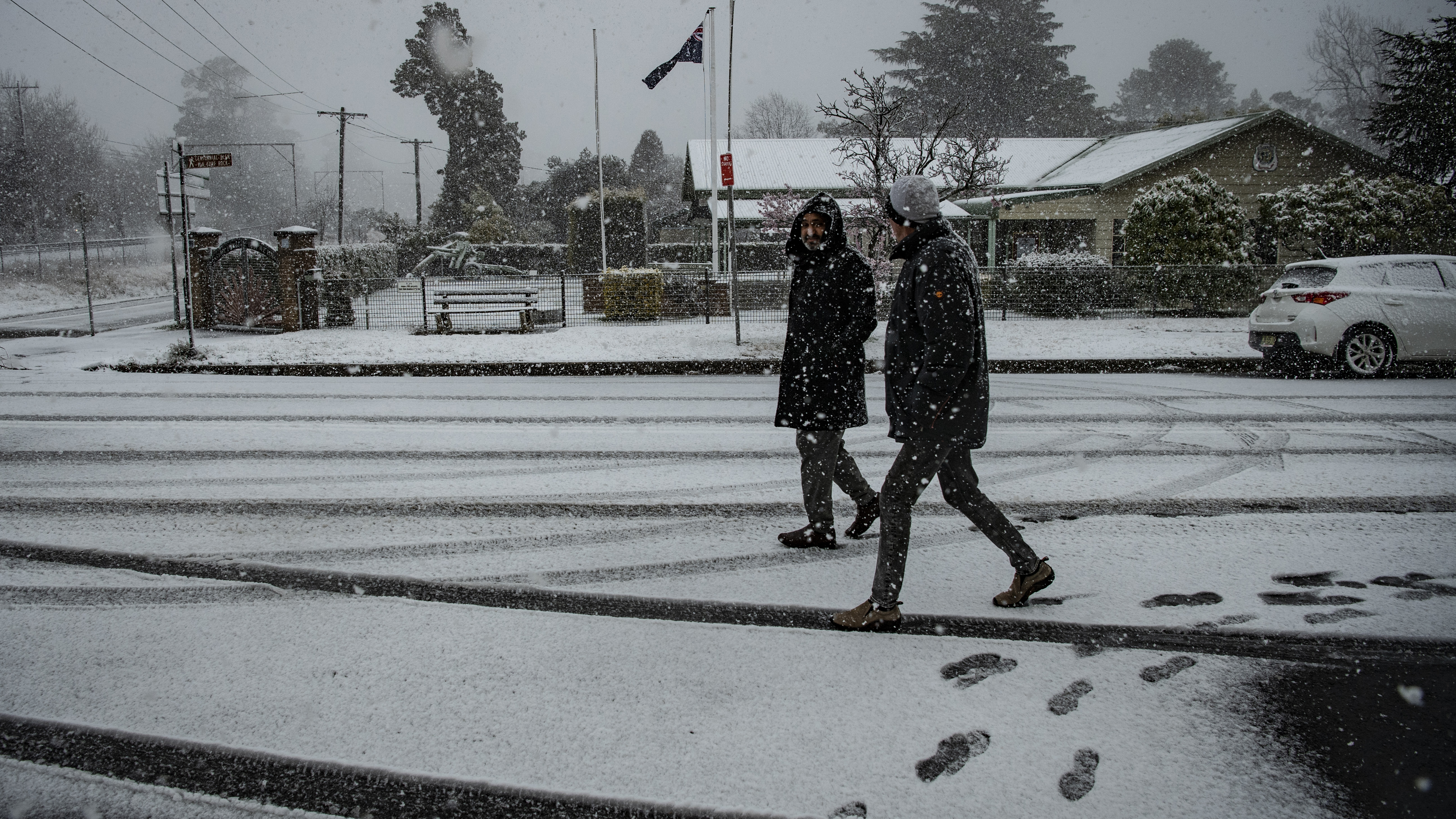 People walk in snow in Blackheath in the NSW Blue Mountains.