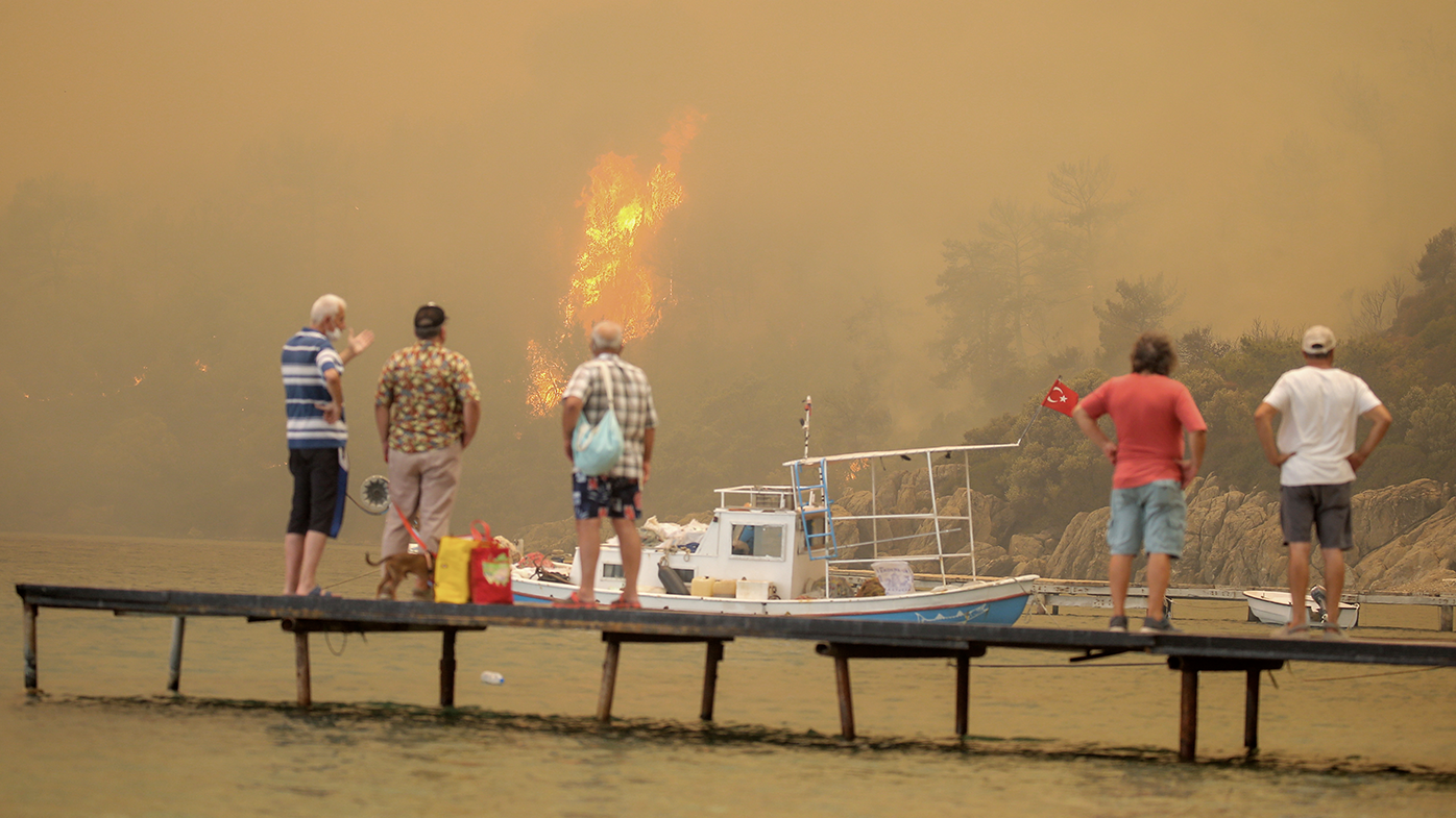 Tourists, villagers flee by boat as wildfires ravage Turkish resorts