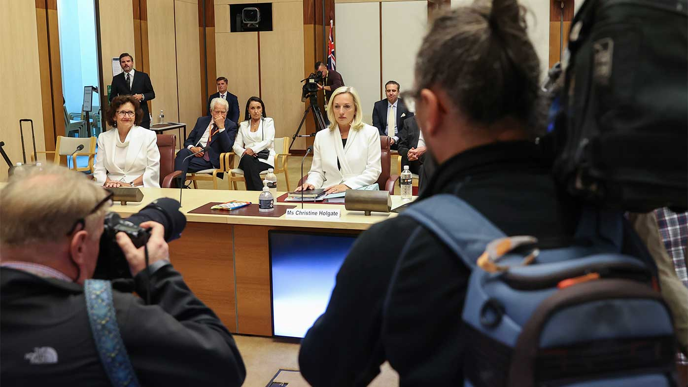 Christine Holgate takes her seat at the start of a hearing on Australia Post at Parliament House.
