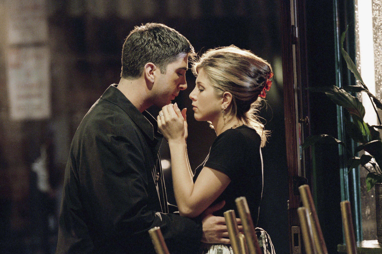 David Schwimmer as Ross Geller, Jennifer Aniston as Rachel Green --