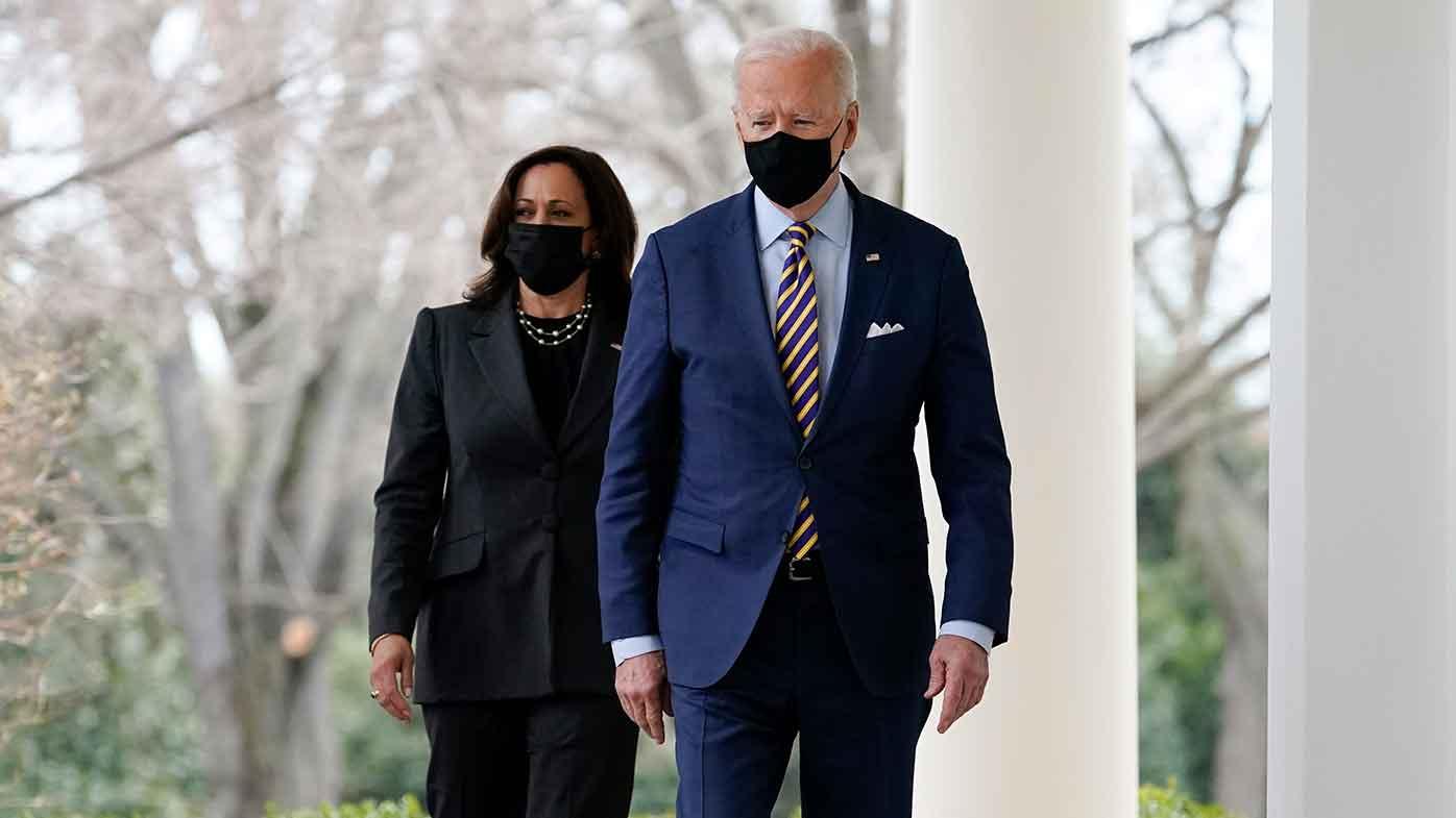 President Joe Biden and Vice President Kamala Harris walk along the White House colonnade as they arrive to speak in the Rose Garden in Washington.