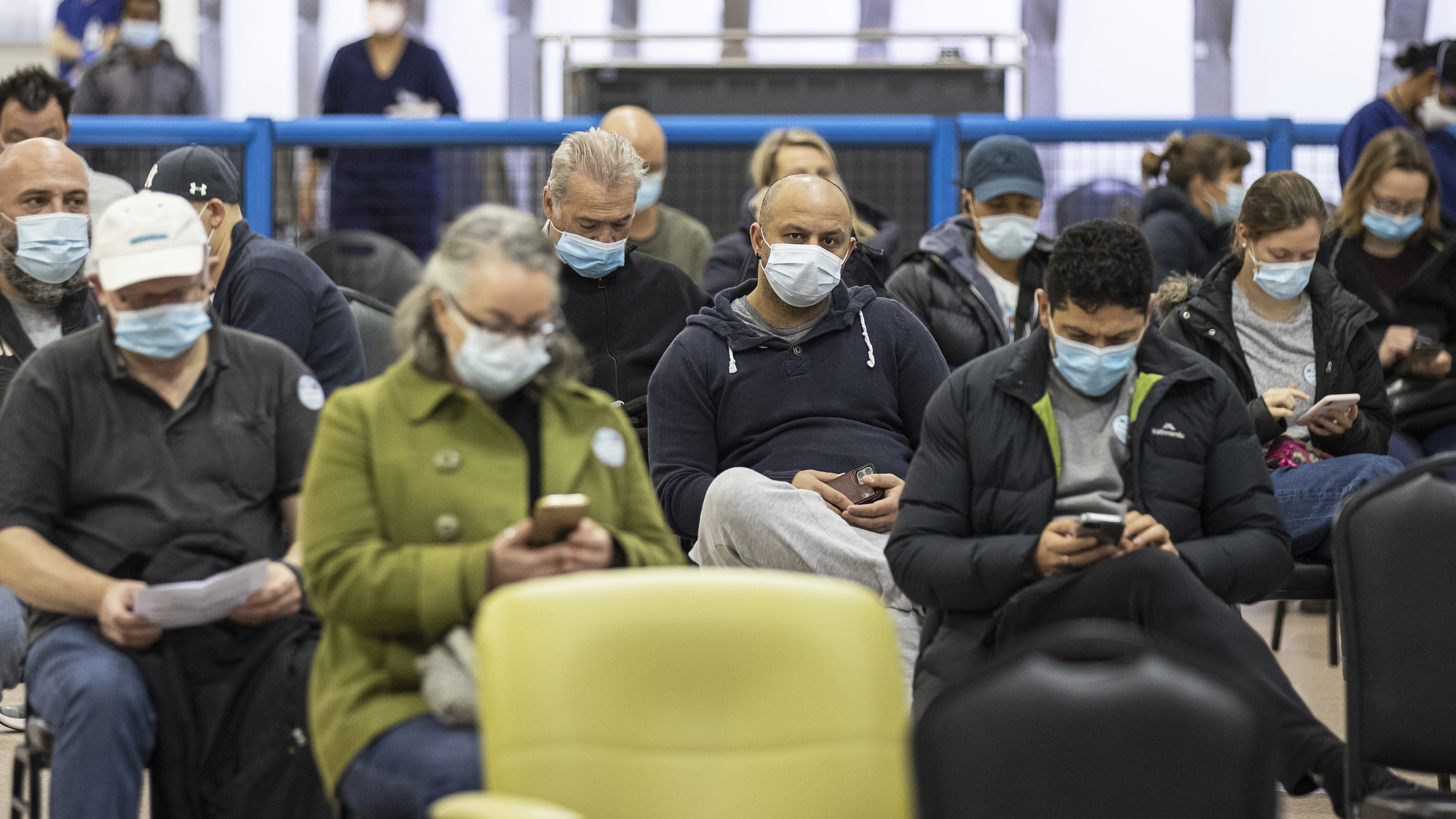 People wait for 15 minutes after receiving a COVID-19 vaccine at the Melbourne Showgrounds COVID-19 Vaccination Centre.