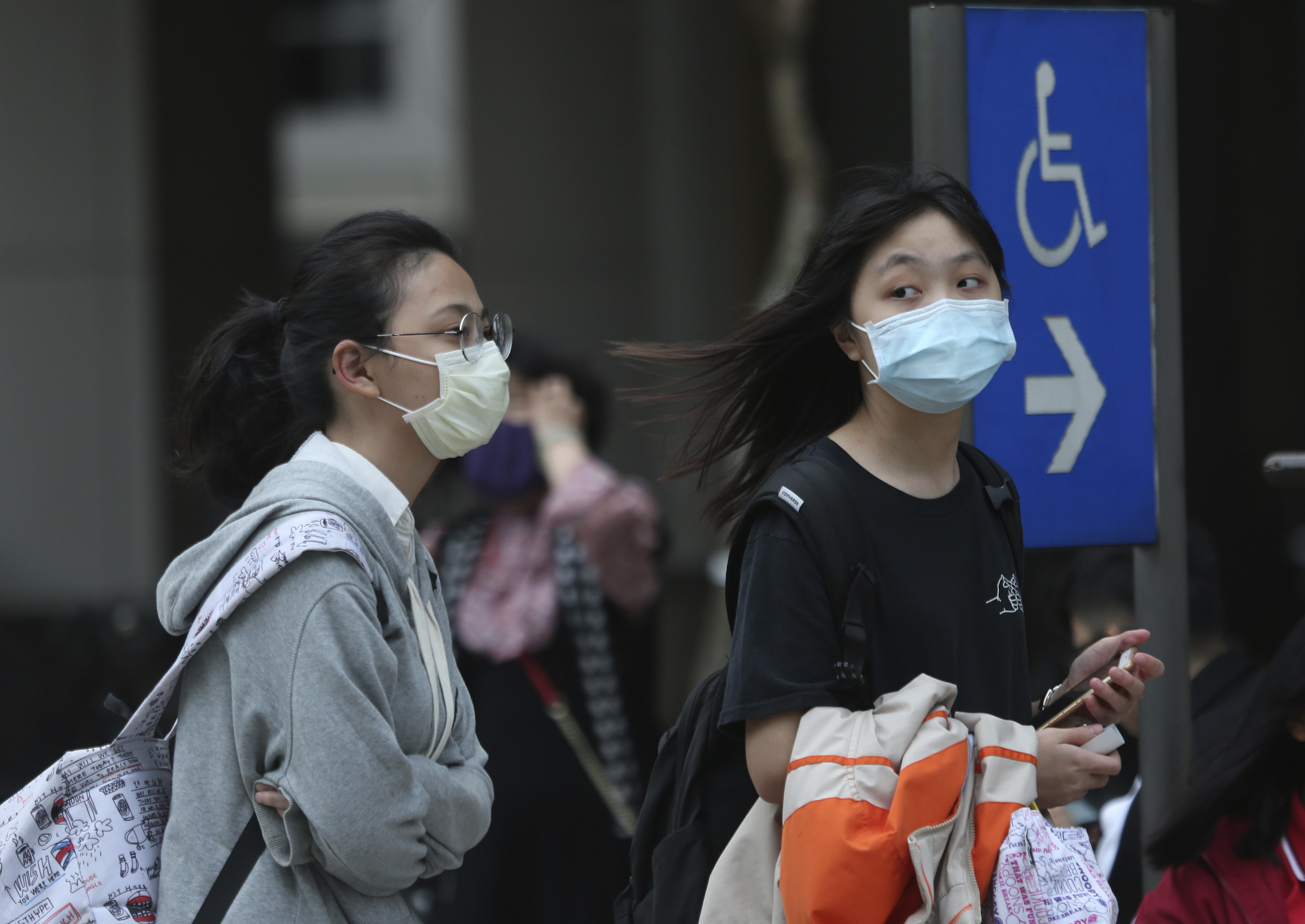 People wear face masks to protect against the spread of the coronavirus in Taipei, Taiwan.