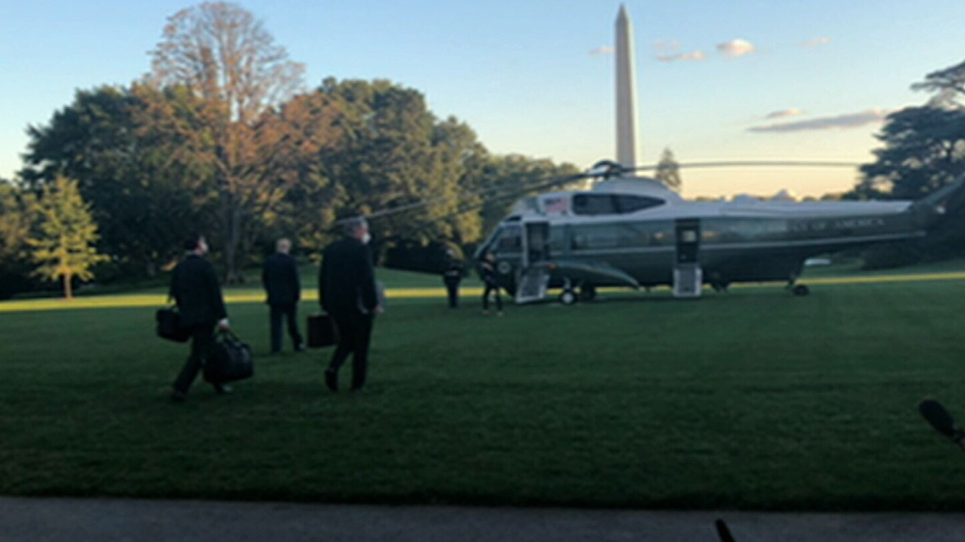 Donald Trump walking to Marine One as he heads to hospital.