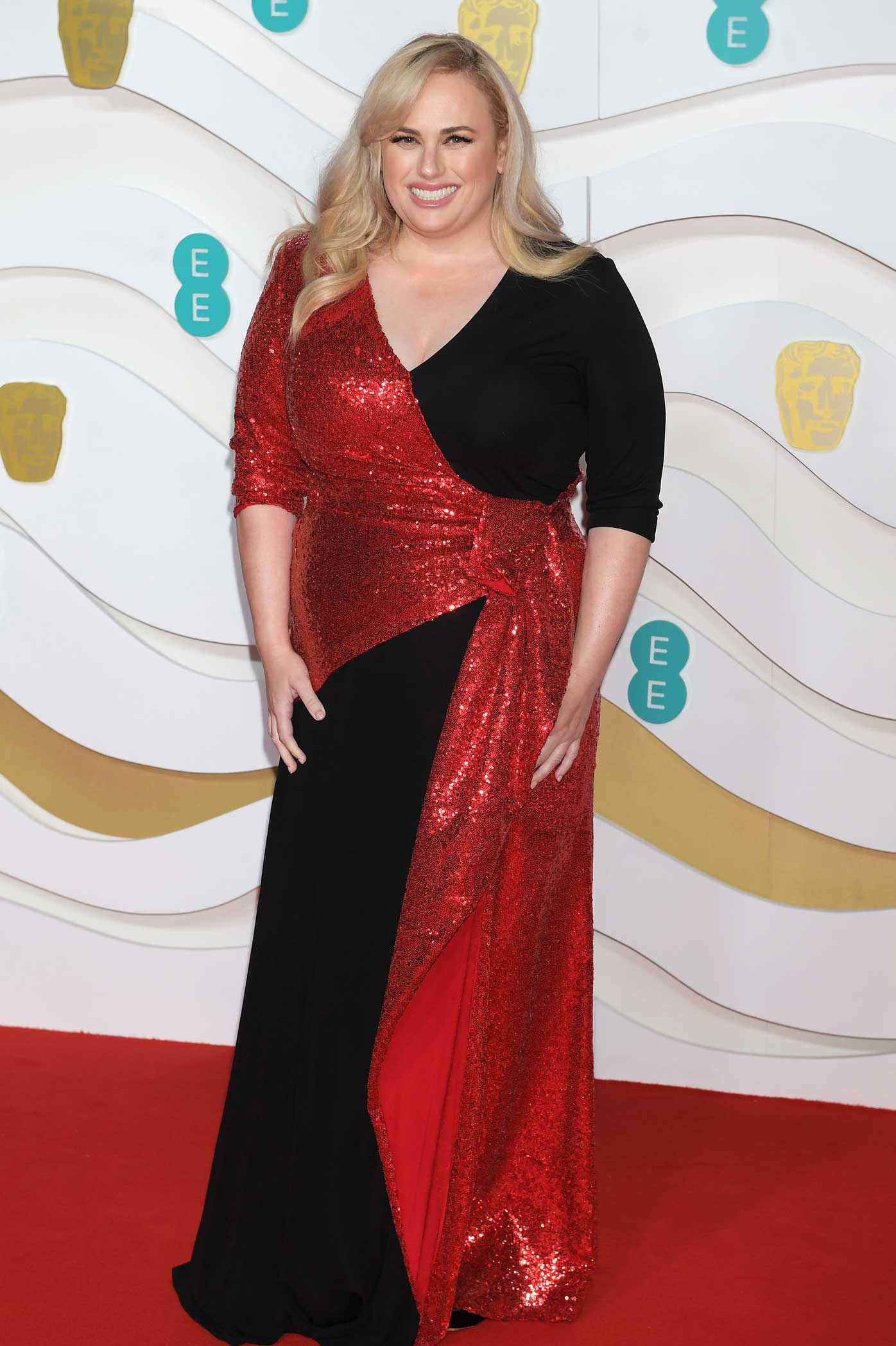 Rebel Wilson arrives at the EE British Academy Film Awards 2020 at Royal Albert Hall on February 2, 2020 in London, England.