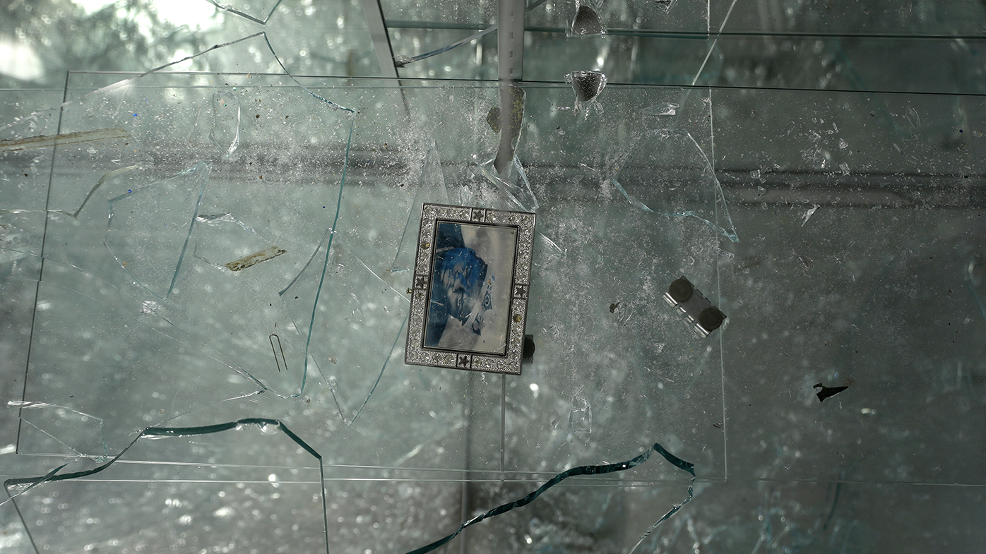 A single photograph is the only thing left in a broken glass case inside Gold & Diamonds store Tuesday, June 2, 2020, in St. Louis. The shop, like several other in downtown St. Louis, was burglarised and ransacked on Monday night. (AP Photo/Jeff Roberson)