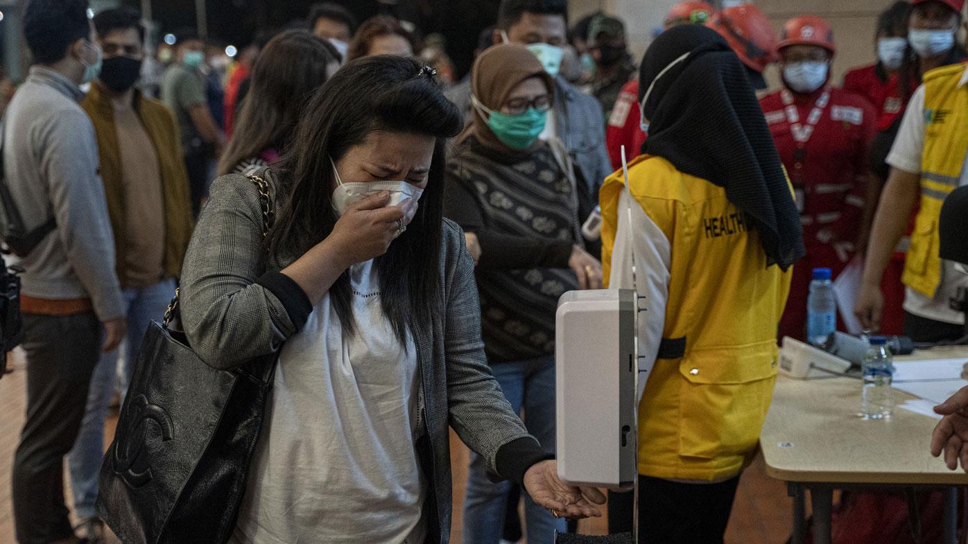 Relatives of Sriwijaya Air flight SJ 182 arrive at the crisis centre in Soekarno Hatta Airport, on January 09, 2021 in Jakarta, Indonesia