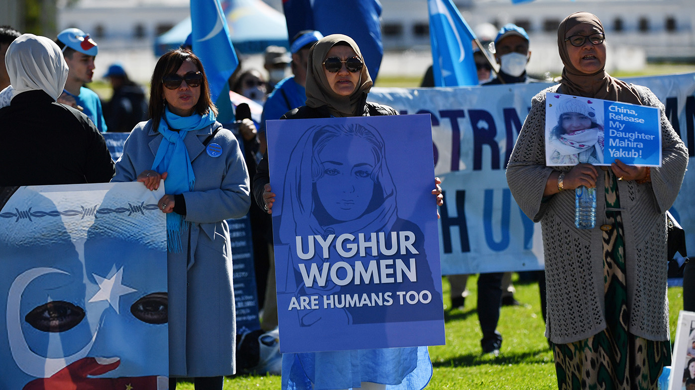 Protesters rally in support of the Uyghur community outside Parliament House in Canberra in March.