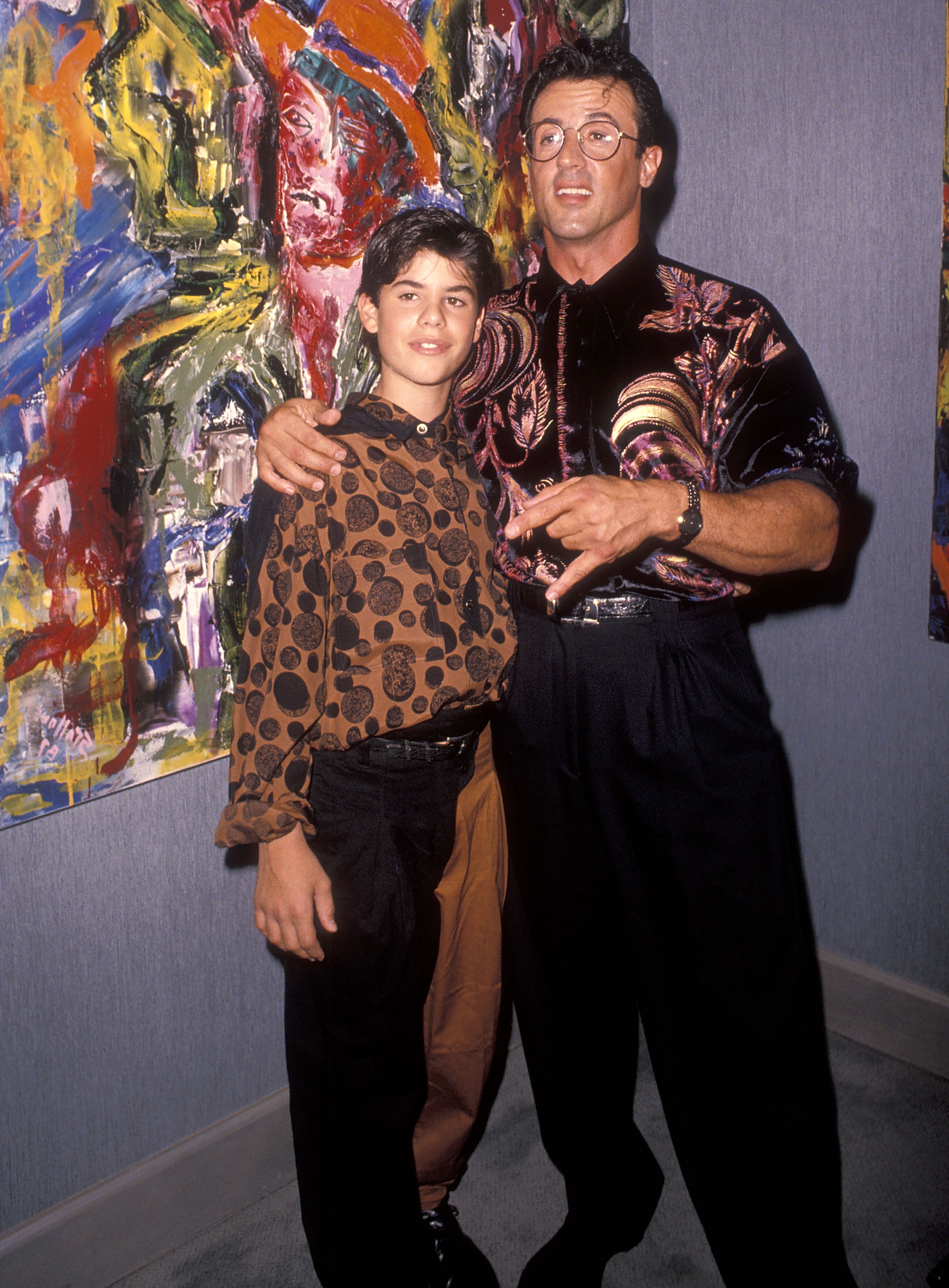"""Actor Sylvester Stallone and son Sage attend Sylvester Stallone's Paintings Opening Night Exhibition and Cocktail Reception to Benefit Yes on Proposition 128 """"Big Green"""" on September 10, 1990 at Hanson Galleries in Beverly Hills, California."""