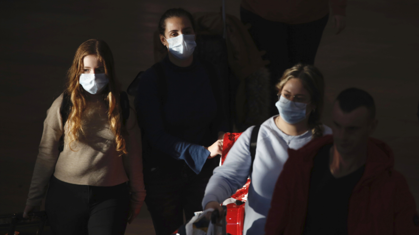 Travellers in protective masks in Israel.